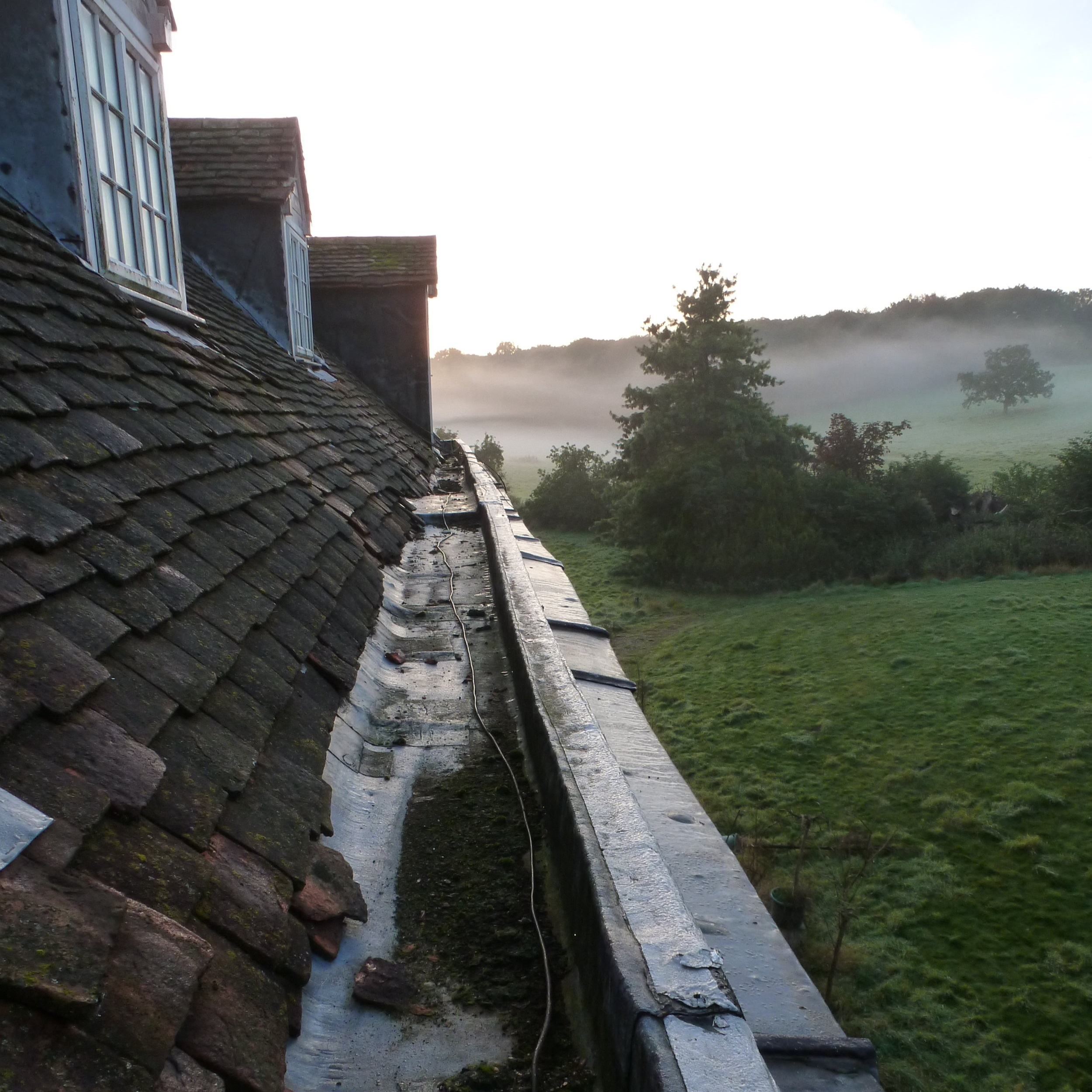 The external parapet gutters were in an extremely poor condition and badly designed from their outset. Many had been replaced with felt, and the lead bays were cracked and in need of repair. The lead drips were too shallow and the bore diameter of the outlets meant that rainwater was backing up and entering the roof beneath the leadwork. The parapet is constructed from 50x50mm battens and was not structurally sound.
