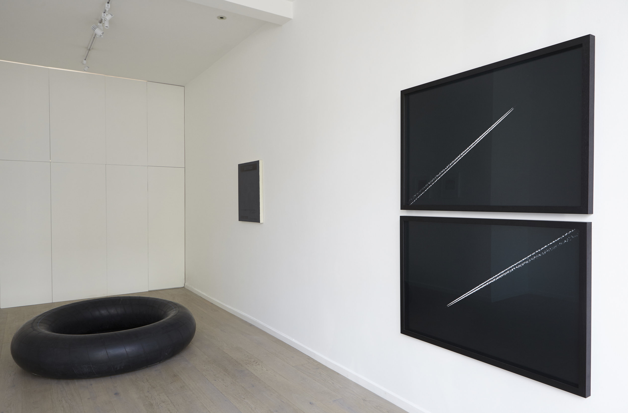 Kingsley Ifill 'Squared circle', 2016, Television, inner tube, one tube of compressed air.    (Piece completed once all air has naturally diffused through rubber).    Dimensions variable.    Kingsley Ifill 'Unpredictable', 2017,  Acrylic on canvas.     Alex Sain 'Fight or Flight' 2017, Pair of identical Ra4 prints with negative