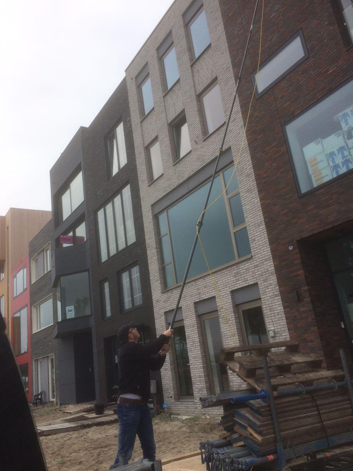TNDB in acite: glasbewassing 3e etage woonhuis