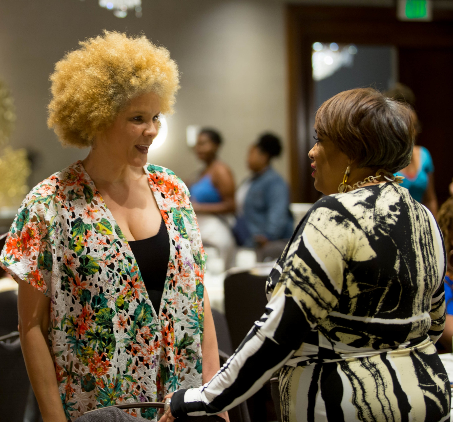 - Acclaimed writer and Decades Supporter Michaela Angela Davis chatting with honoree Dyana Williams before the brunch.