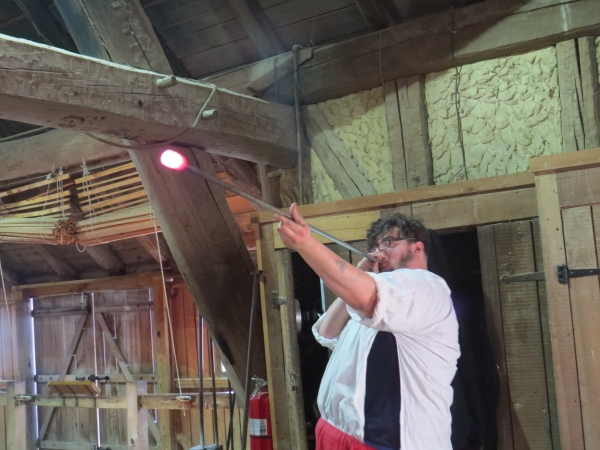 Apprentice glassblower at Historic Jamestowne Glasshouse exhibit.
