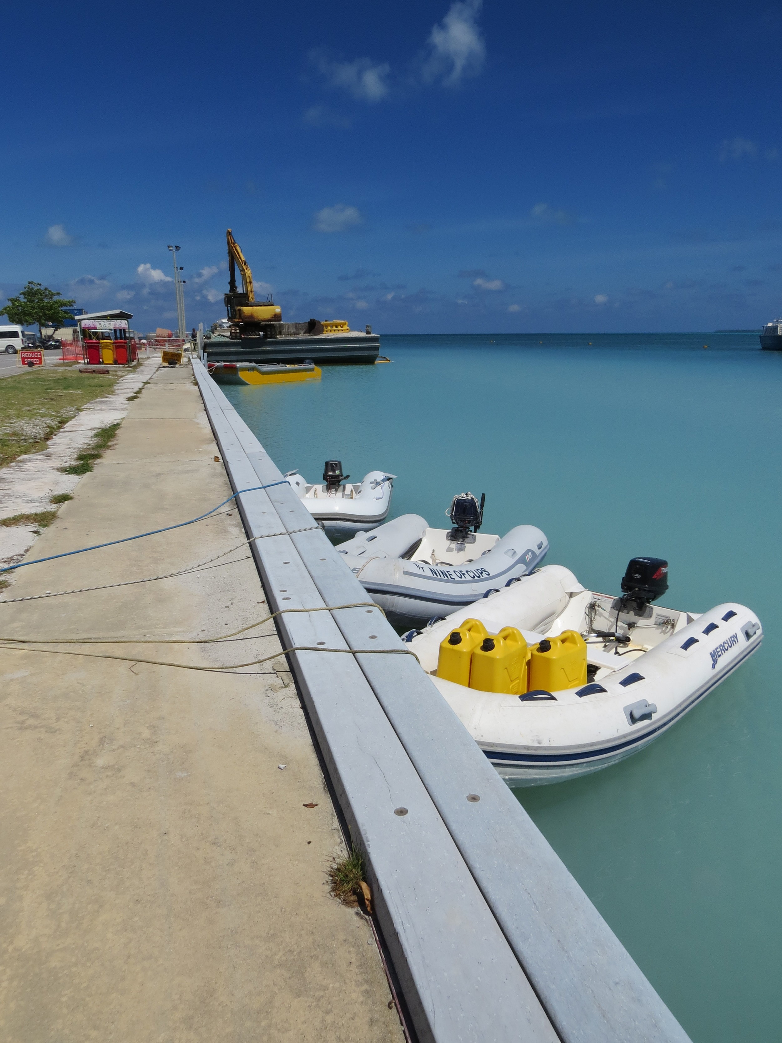 Dinghies tied to the dock