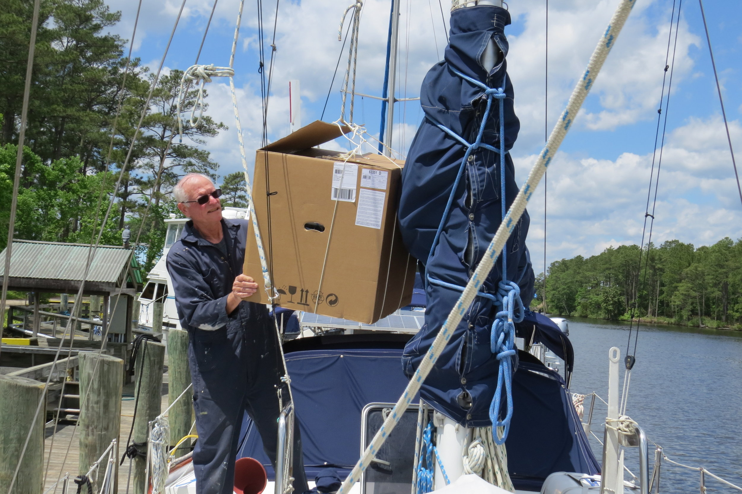 We used the windlass to hoist it up and lowered it through the saloon hatch.