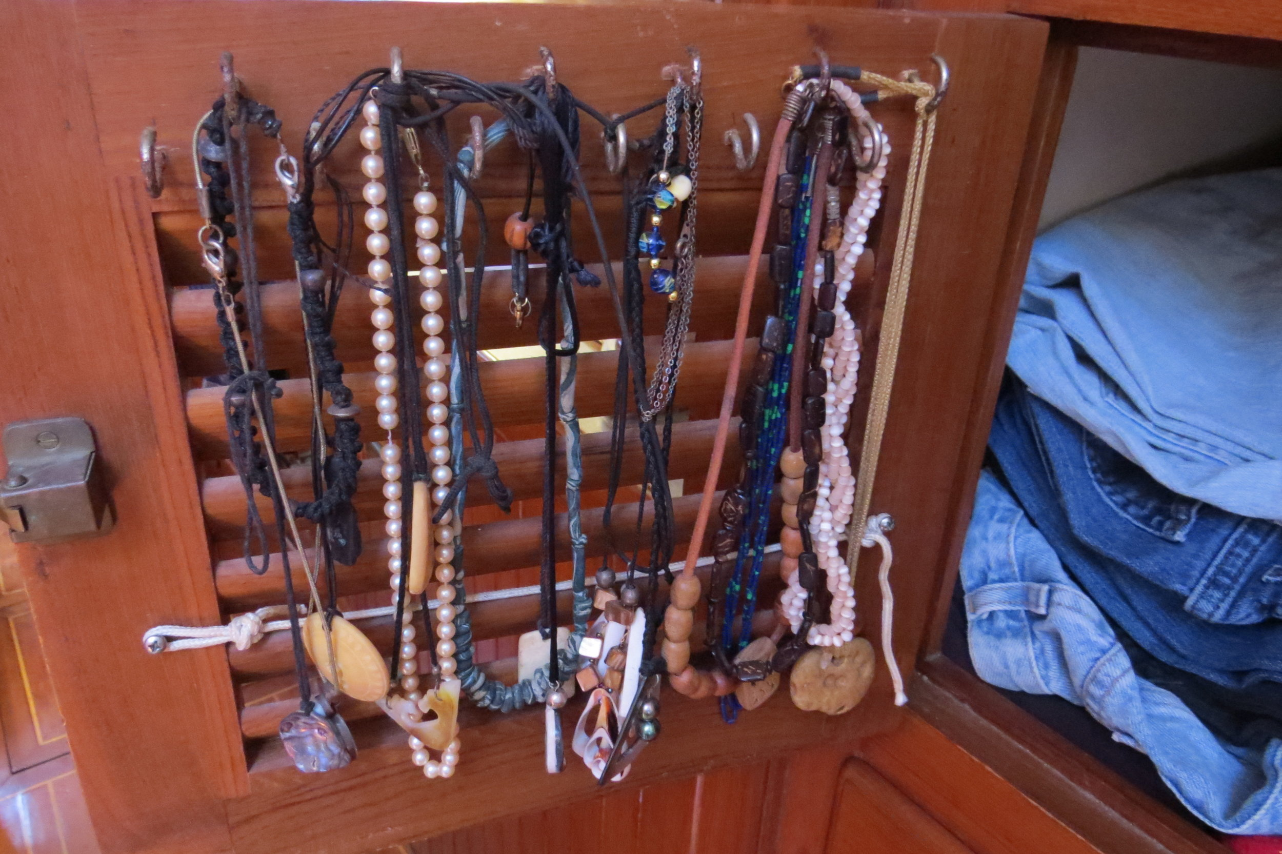 The inside of a locker door was the perfect place to hang necklaces and keep them untangled.