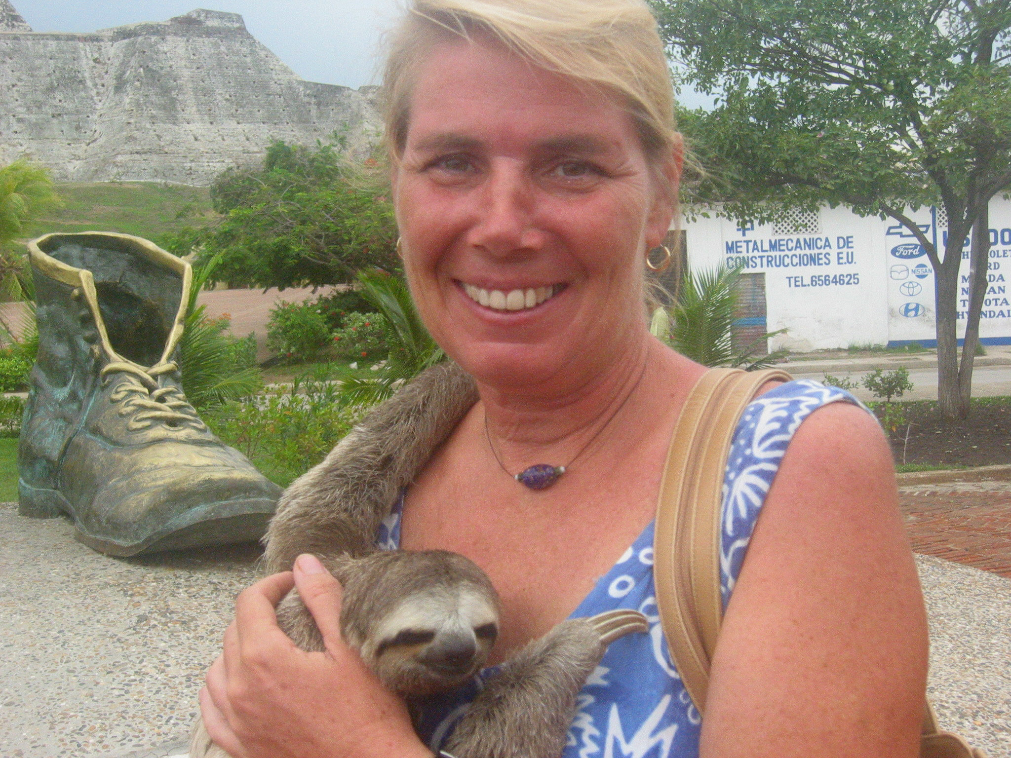 Photo opp with a sloth and an old shoe??
