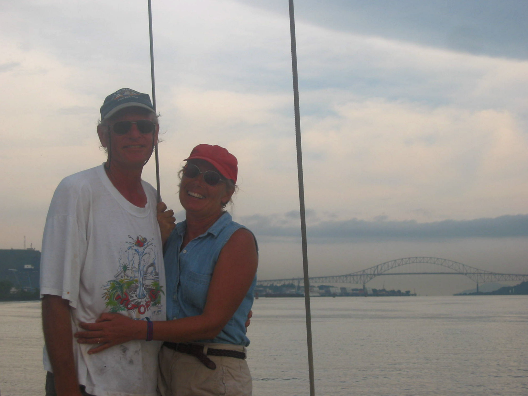 "Hot, sweaty long transit of the Panama Canal ... Bridge of Americas which ""connects"" North and South America is in the background ... the gateway to the Pacific Ocean."
