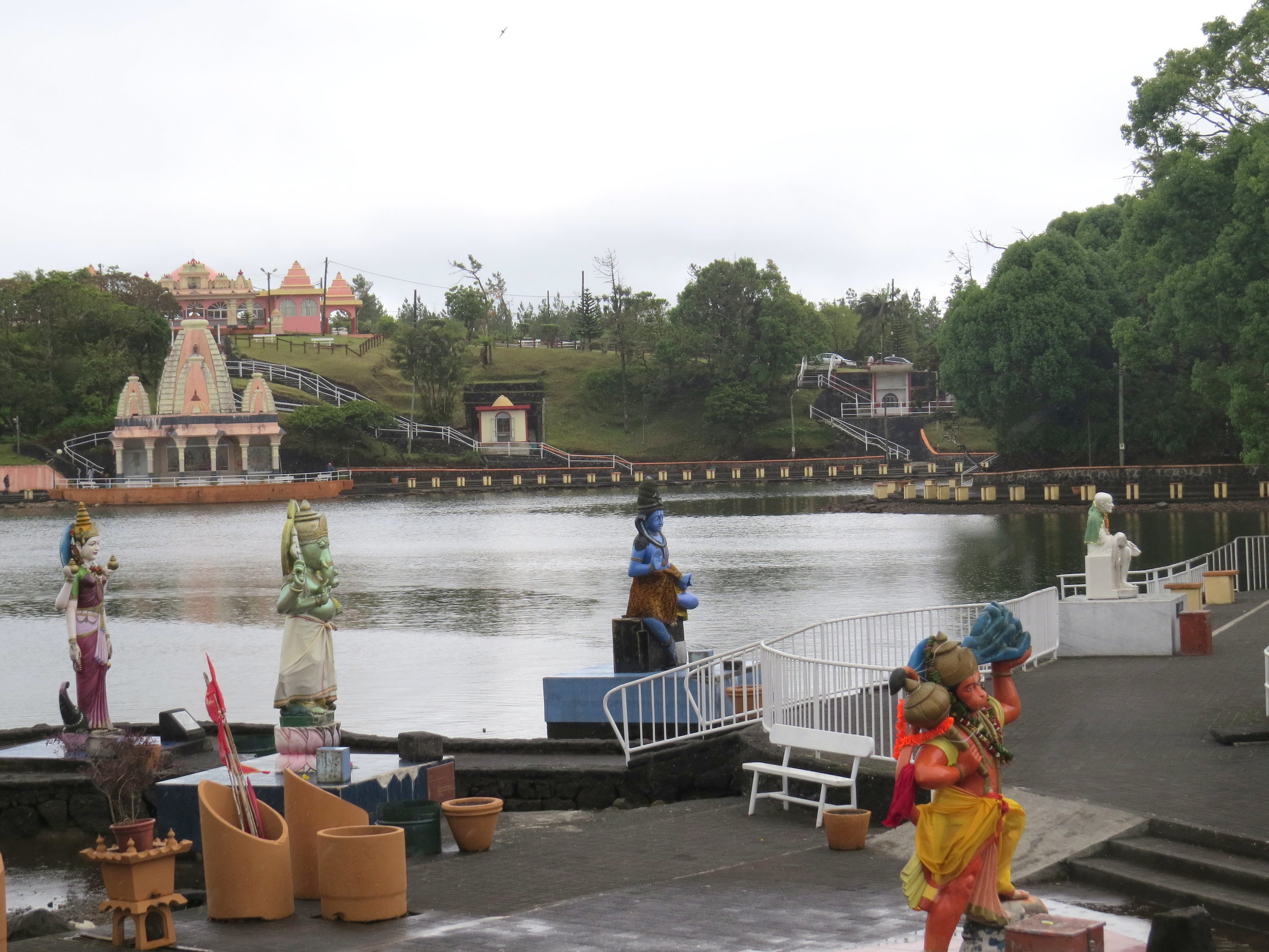 We walked along the lake and came to what we determined was the main temple. There were large statues of Hindu deities scattered along the lake's edge, many with offerings at their feet.