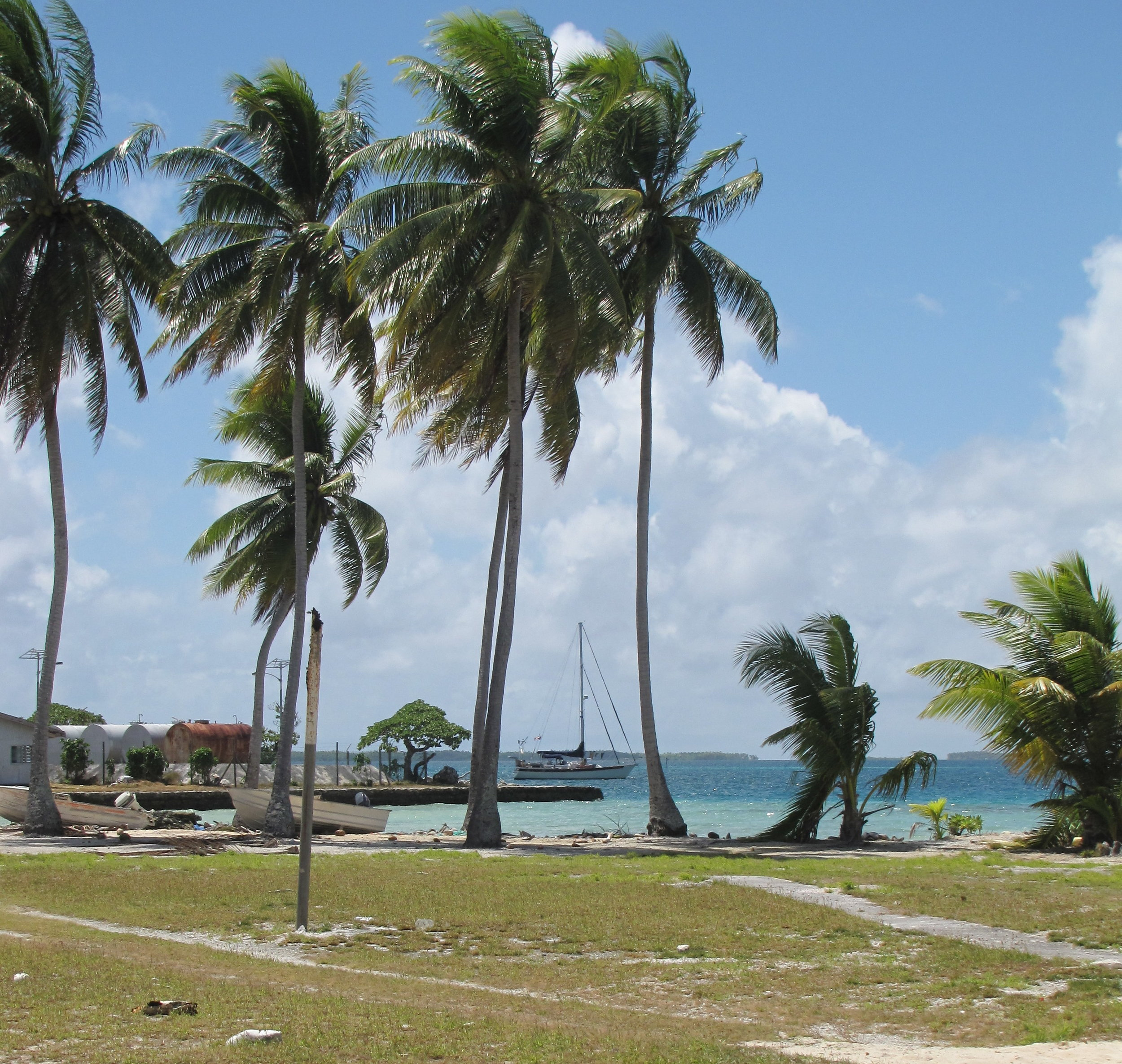 Nine of Cups anchored off the tiny village of Omoka at Penrhyn atoll, cook islands