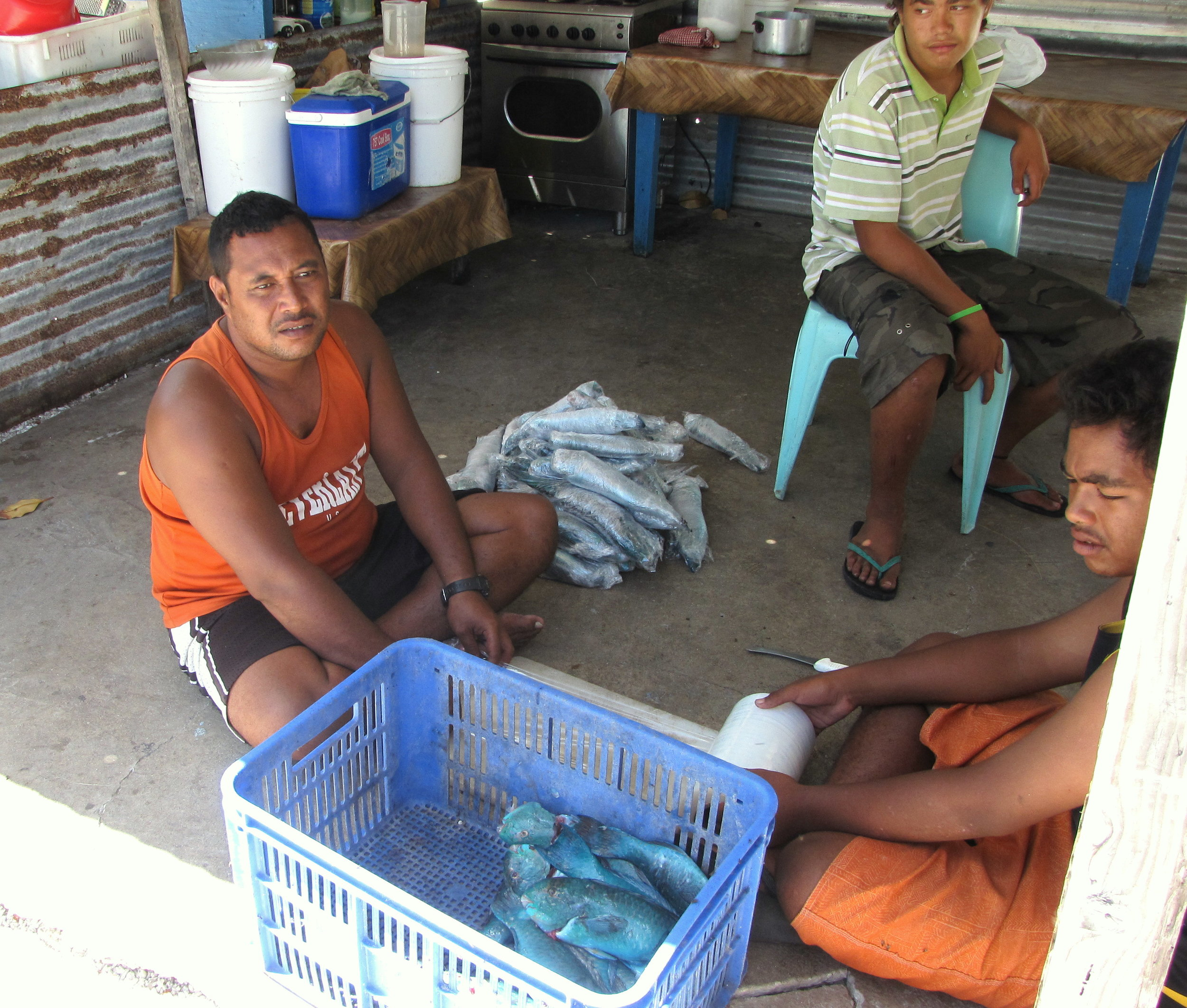 Fishermen with their parrot fish catch.