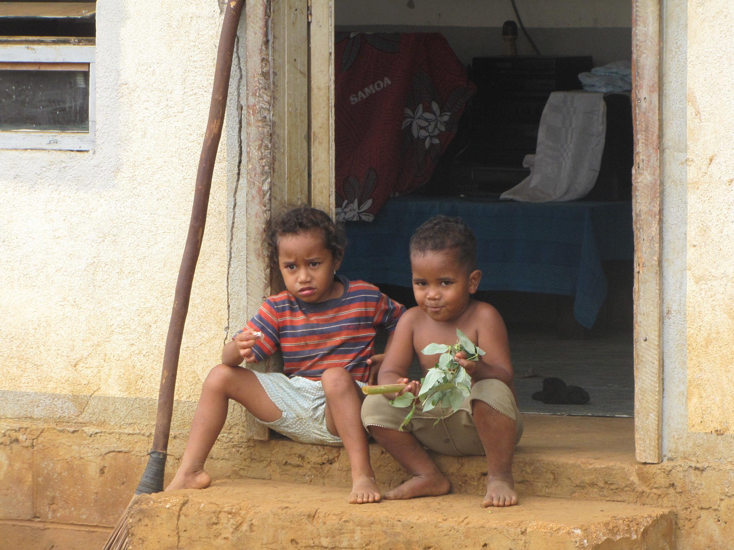 Local kids sitting in a doorway