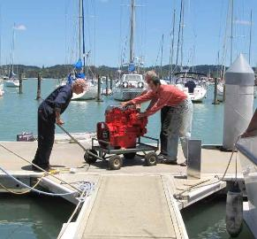 Slowly roll new engine down the dock and back to Cups. Yikes!