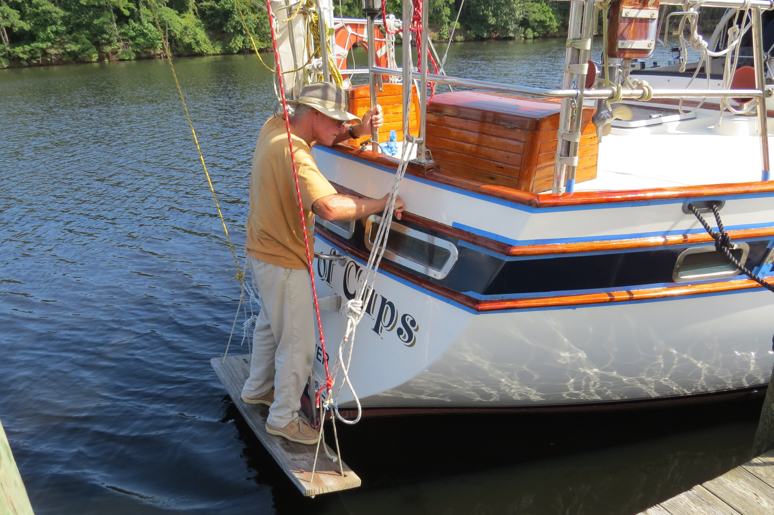 Removing masking tape from newly varnished stern rails
