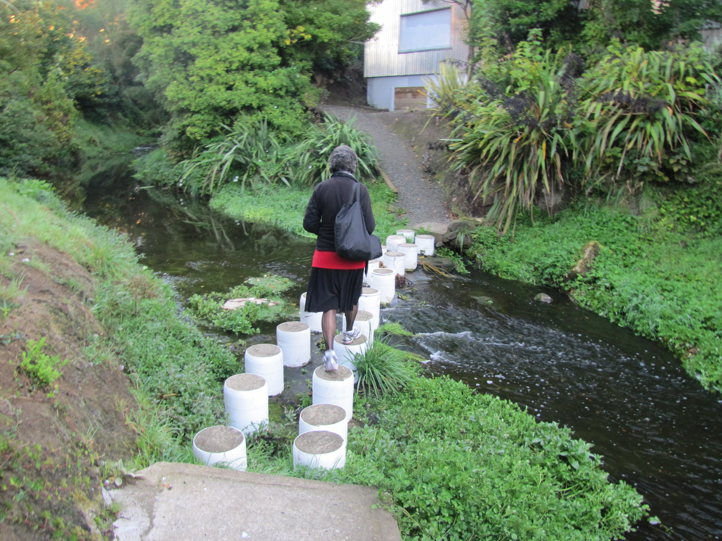 Betsy hops the stepping stones on her way to work.