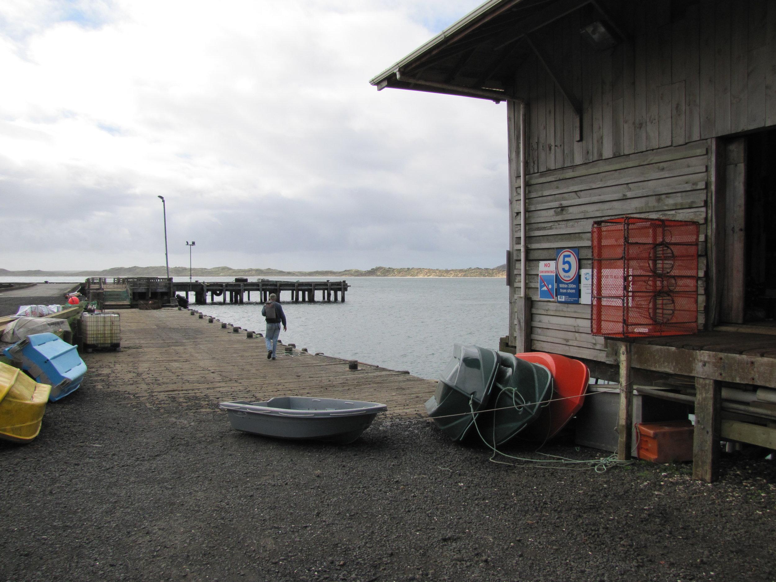 Checking the dinghy at the Waitangi wharf