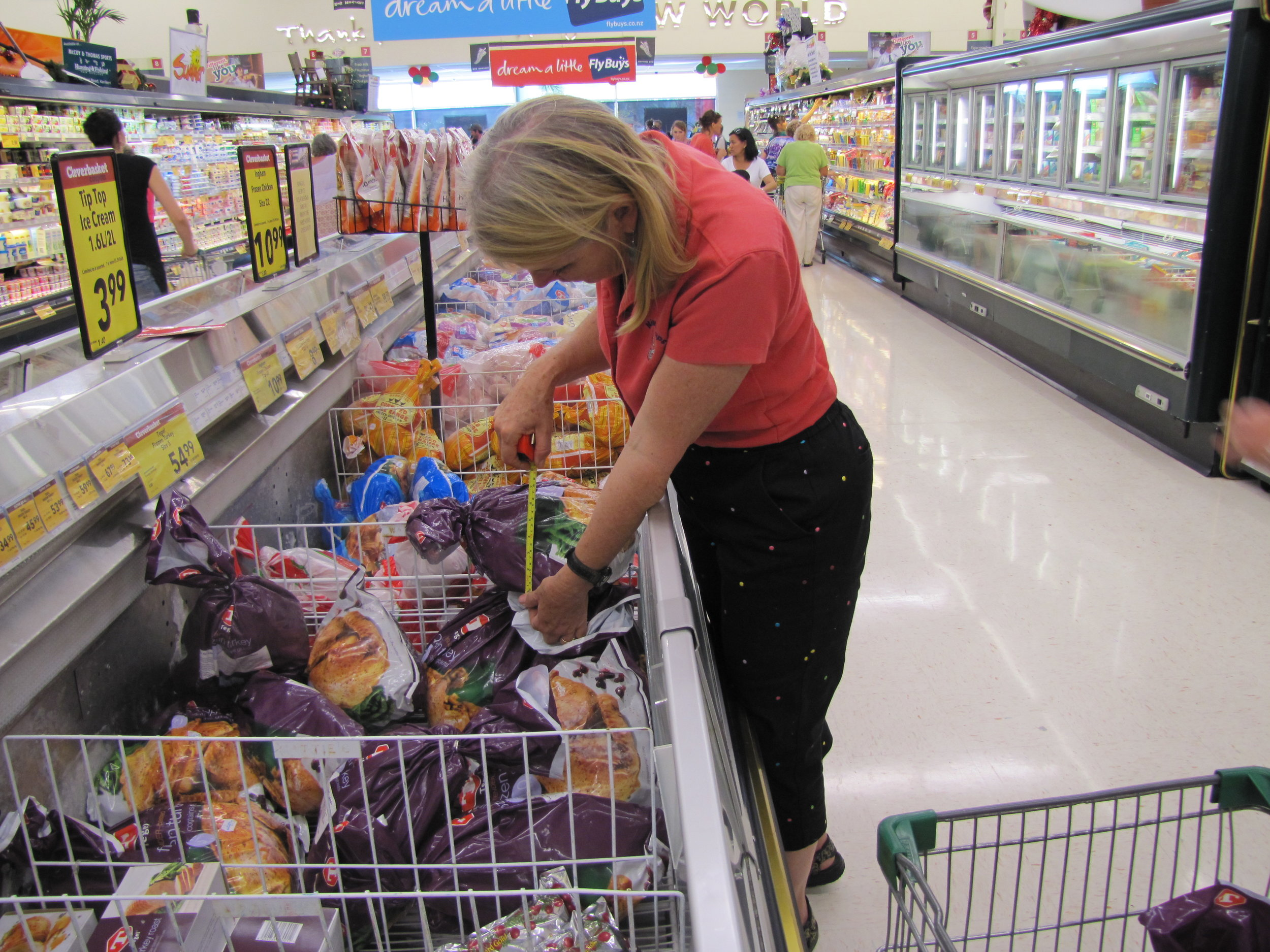 Marcie had to measure the frozen turkey in NZ to make sure it would fit in Cups' oven.