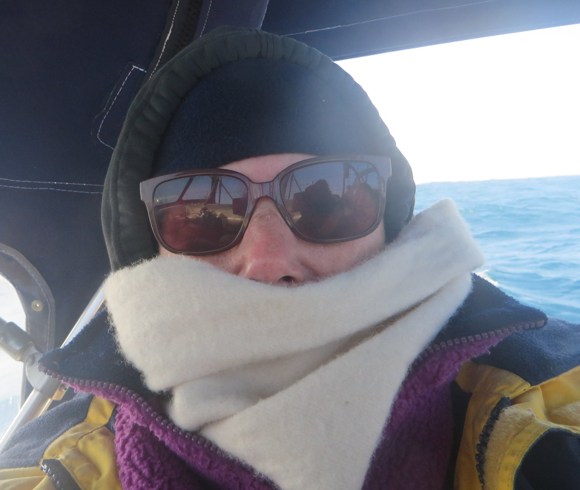 The passage from Namibia to St. Helena Island was cold and raw. Shivering selfie at sea!