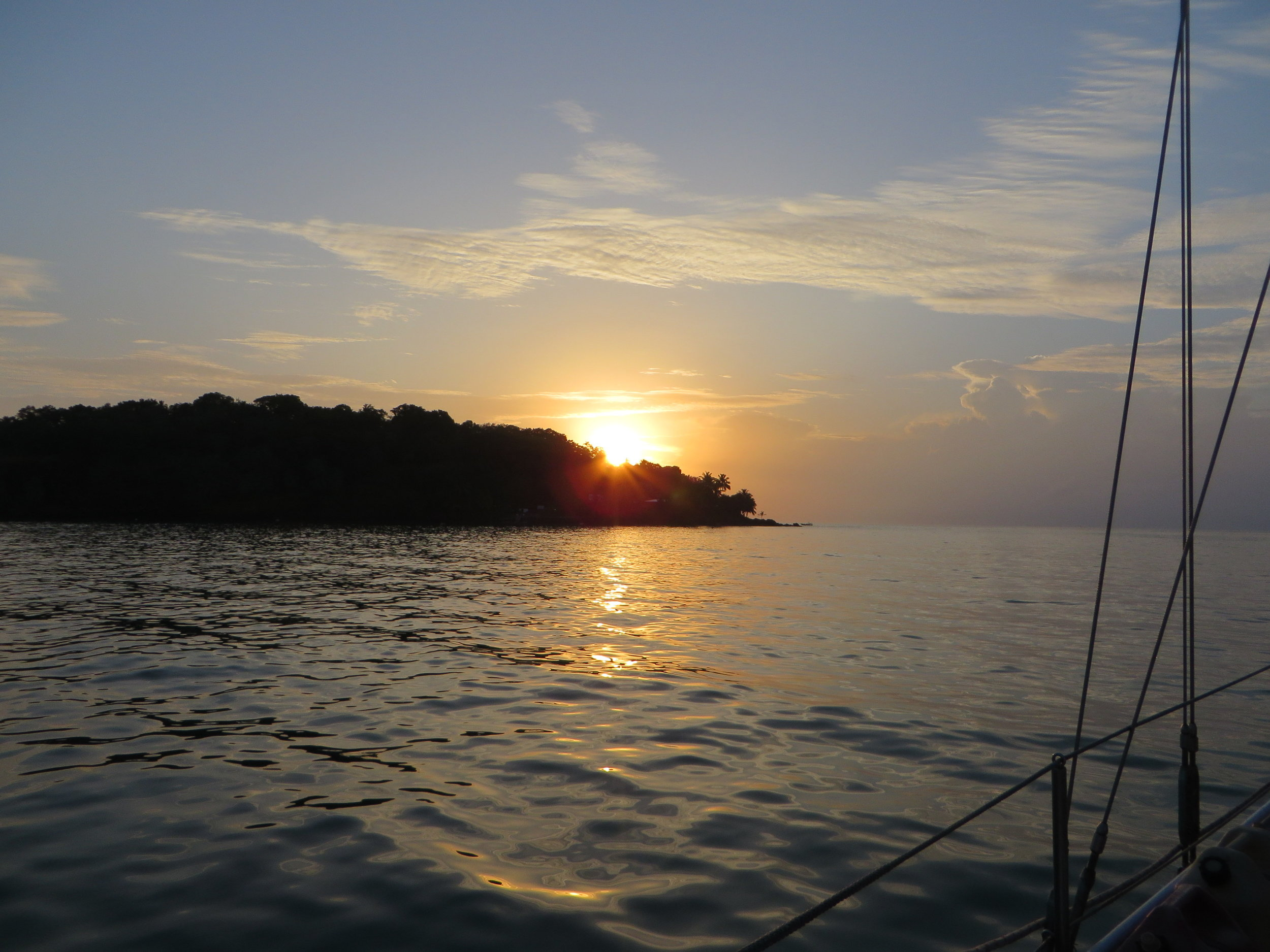 Anchored at Iles du Salut, French Guiana ... a beautiful sunrise after 26 days at sea.