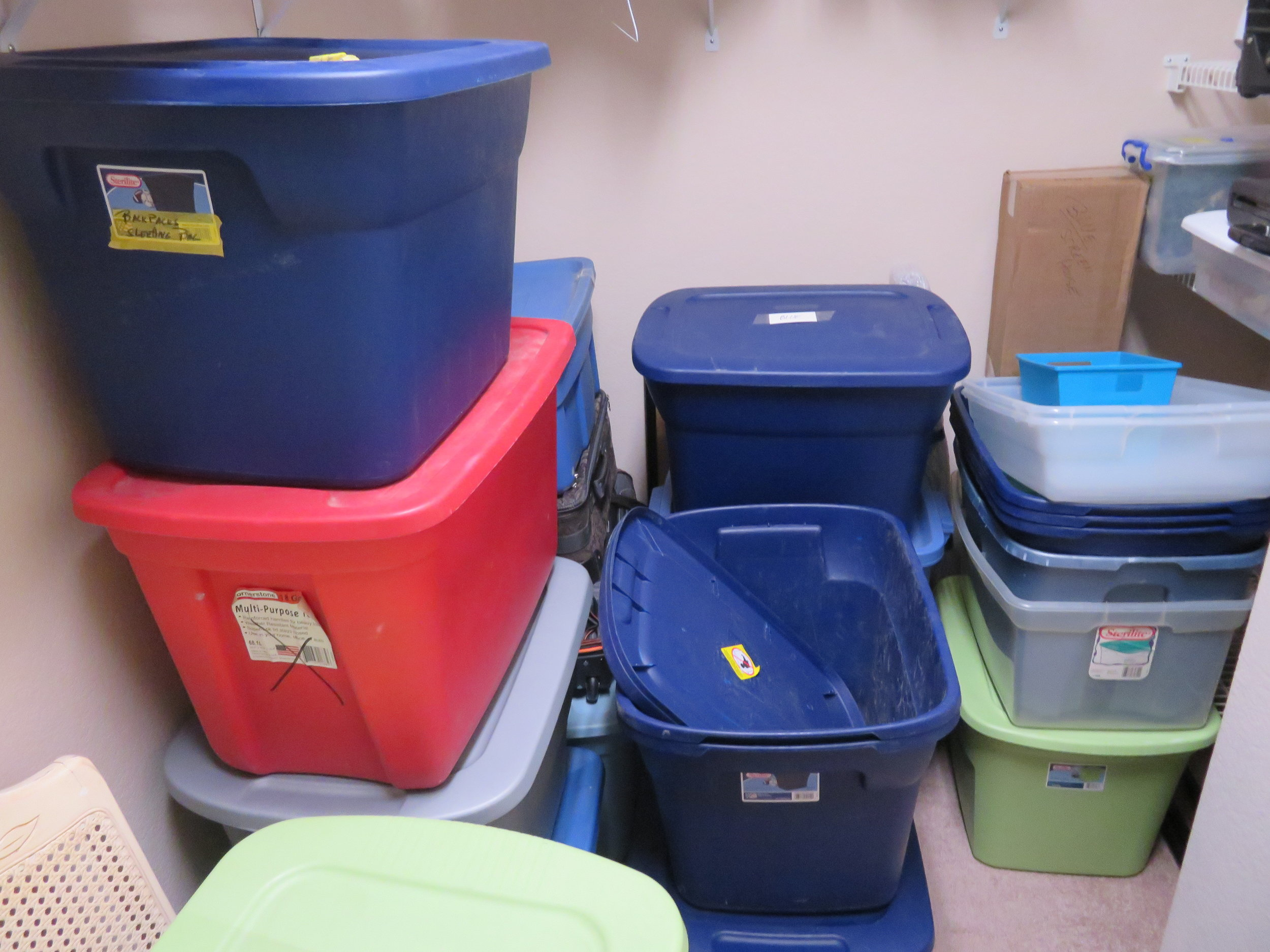 Tubs 'o' stuff in Mary's more-than-adequate closet.