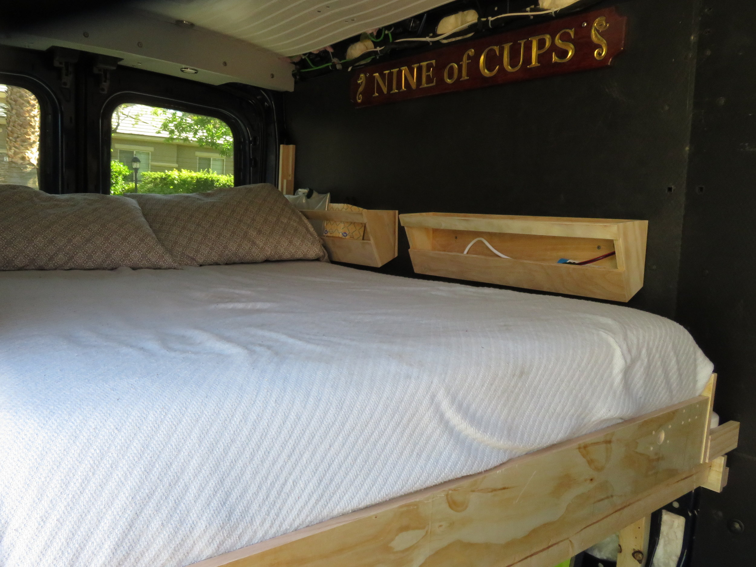 The last detail … David mounted our 'Nine of Cups' sign board the bed … a fond reminder of our world travels past and all the miles and adventures that lie ahead.