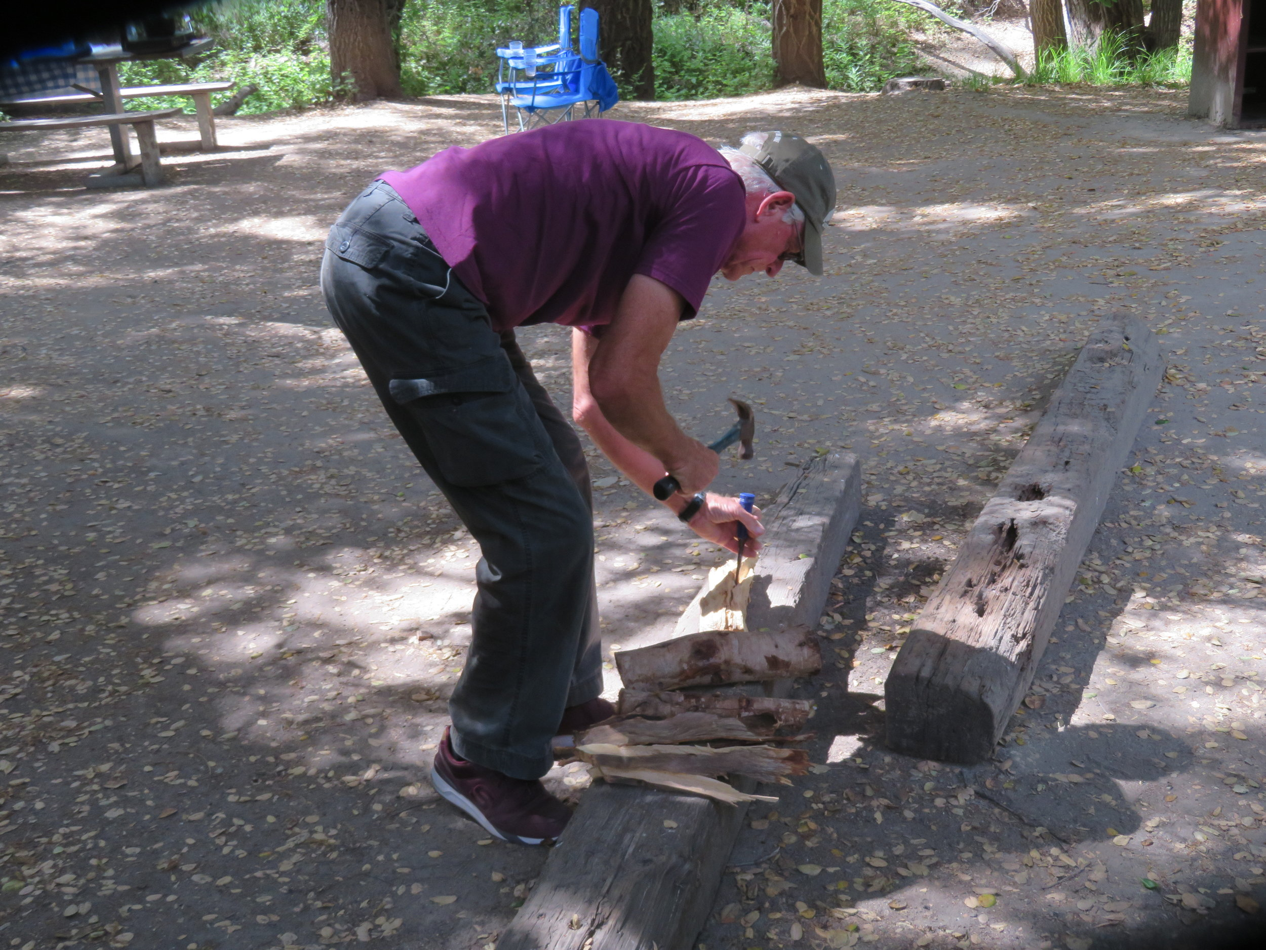 A hammer & chisel worked for splitting firewood, but we put a hatchet on the 'buy list'.