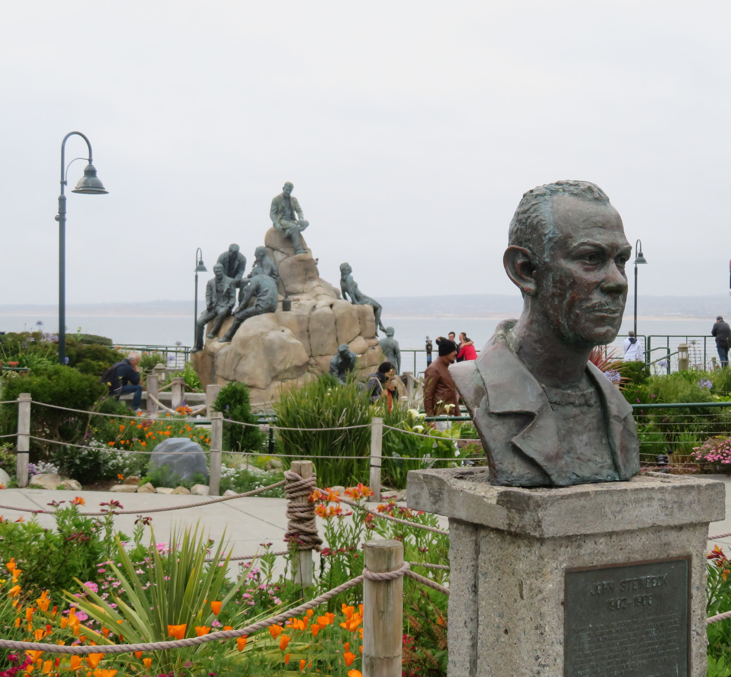 A bust of Steinbeck and the Cannery Row Monument
