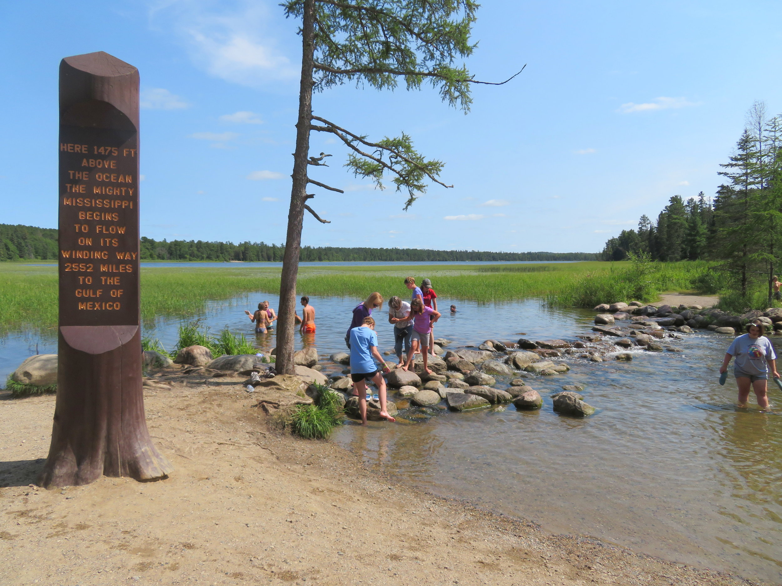 The line of rocks separates Lake Itasca from the headwaters of the Mississippi