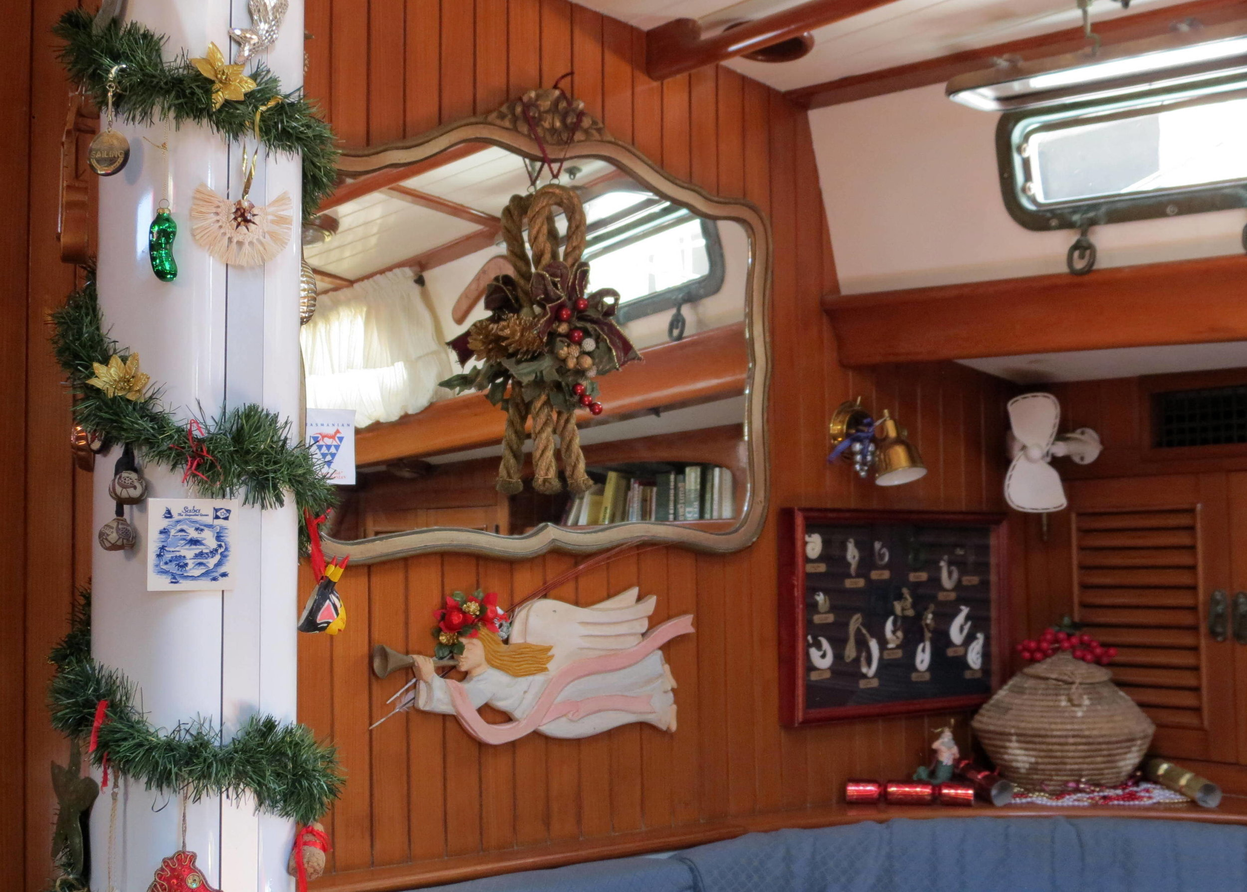 When we lived aboard Nine of Cups, we decorated the mast instead of a tree.