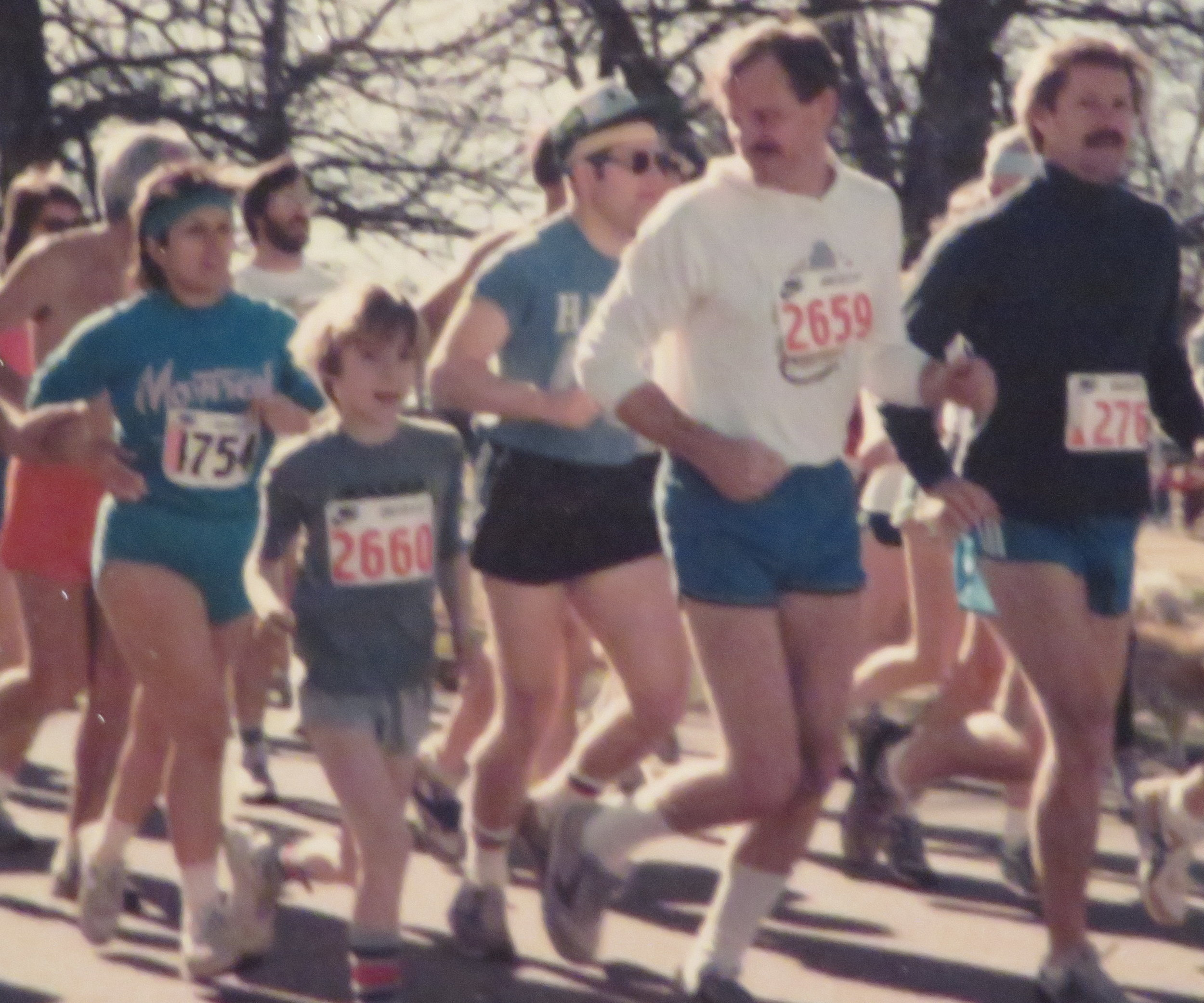 Brennan and David running a 10K in the mid 80s.