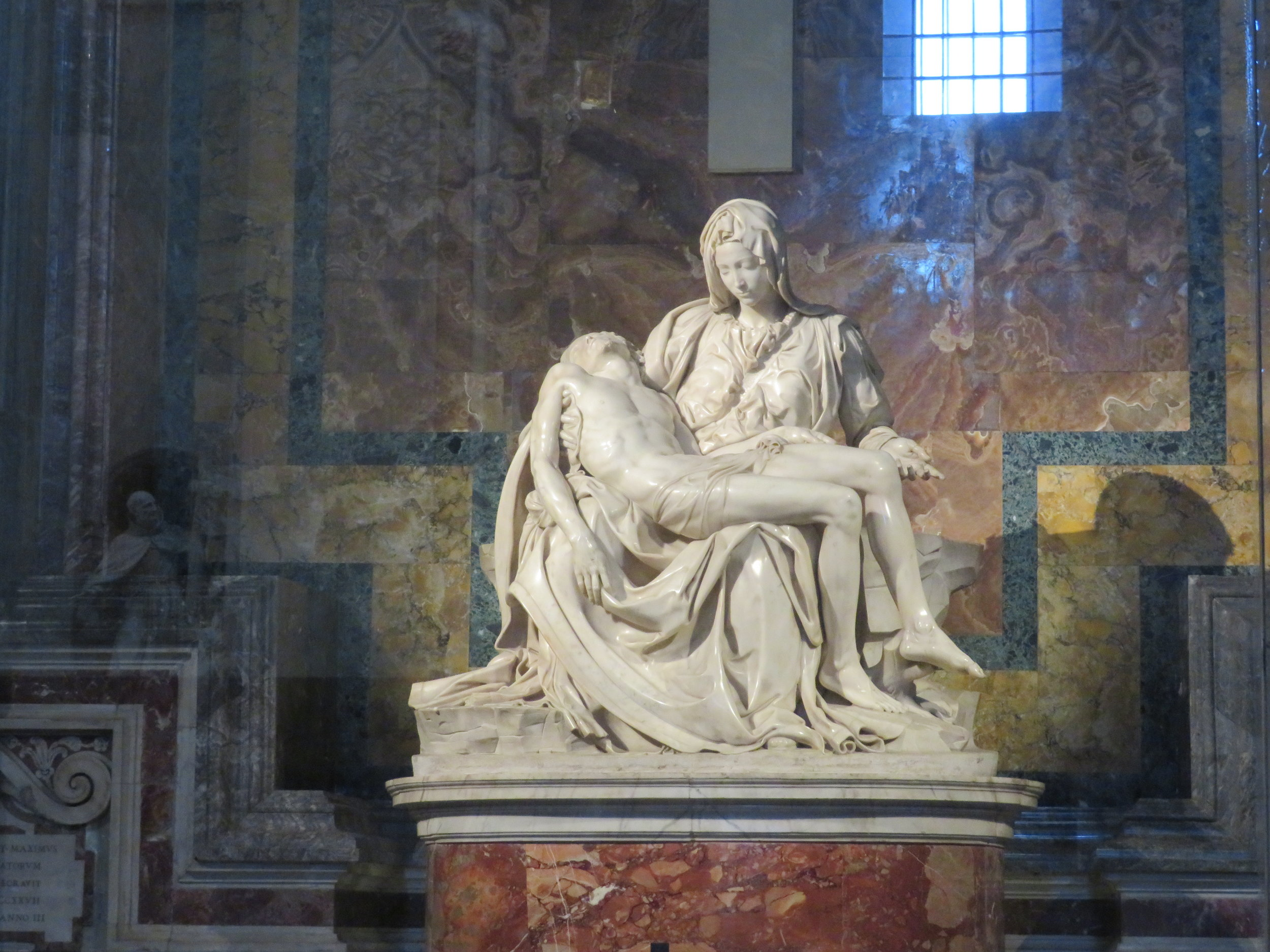 The Pieta by Michelangelo. This is one of few pieces that Michelangelo signed and actually used his whole name, Michelangelo di Lodovico Buonarroti Simoni which is unobrusively carved on Mary's belt.