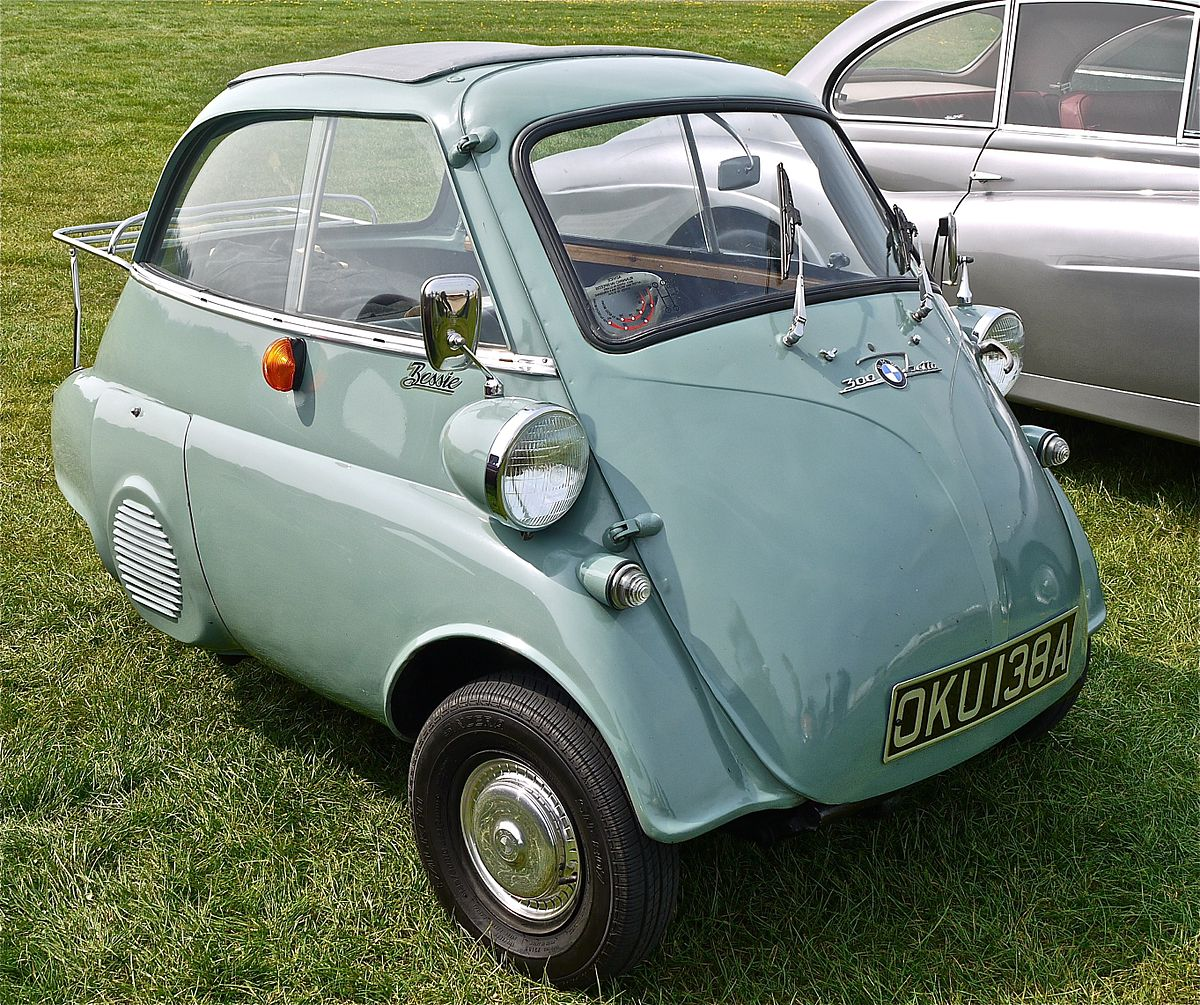 A three- wheeled Isetta - first car to get 98 MPG. It also fits in a medium sized backpack