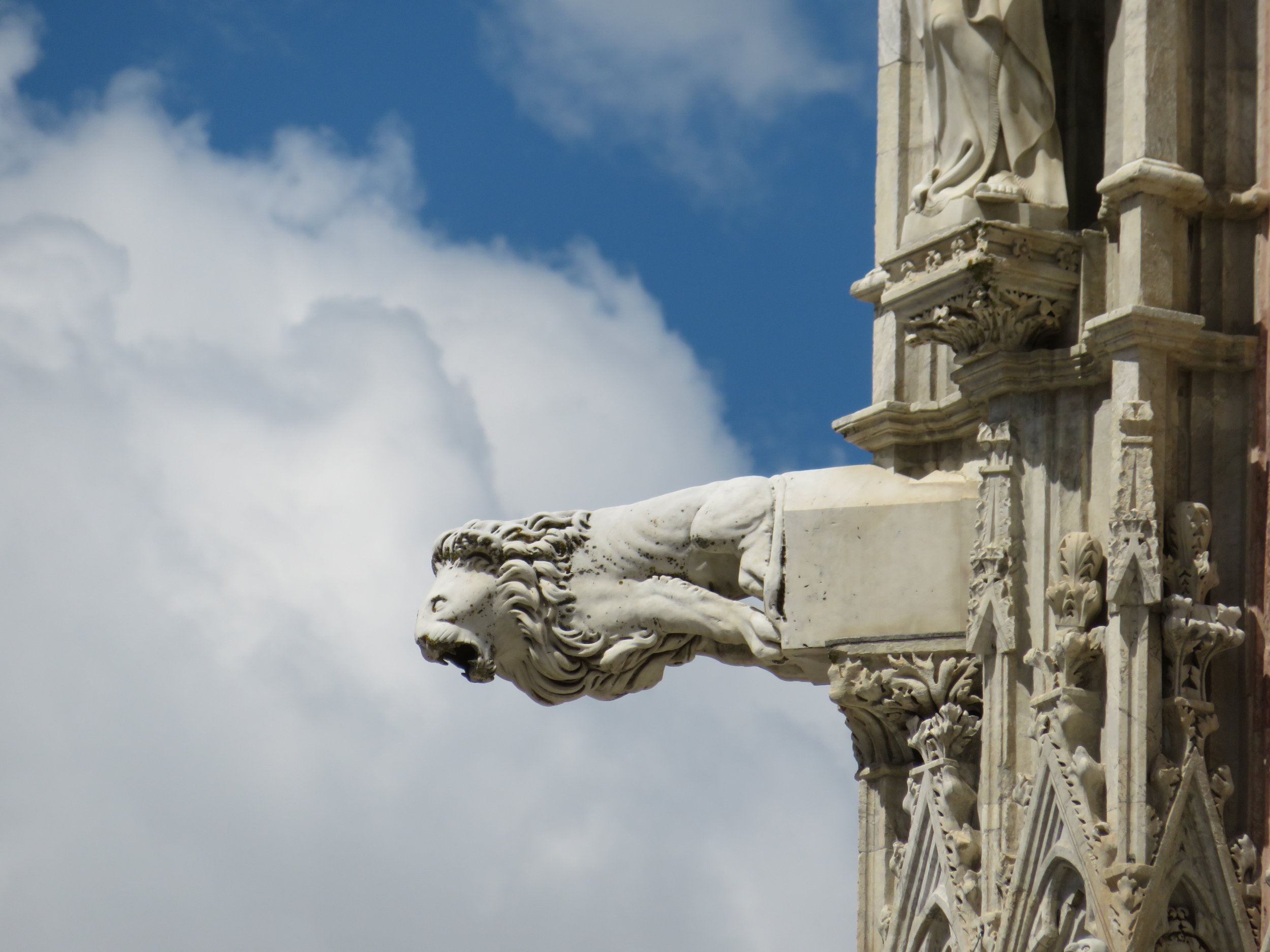 Gargoyles, grotesques, saints and demons adorn the intricate facade of this cathedral.