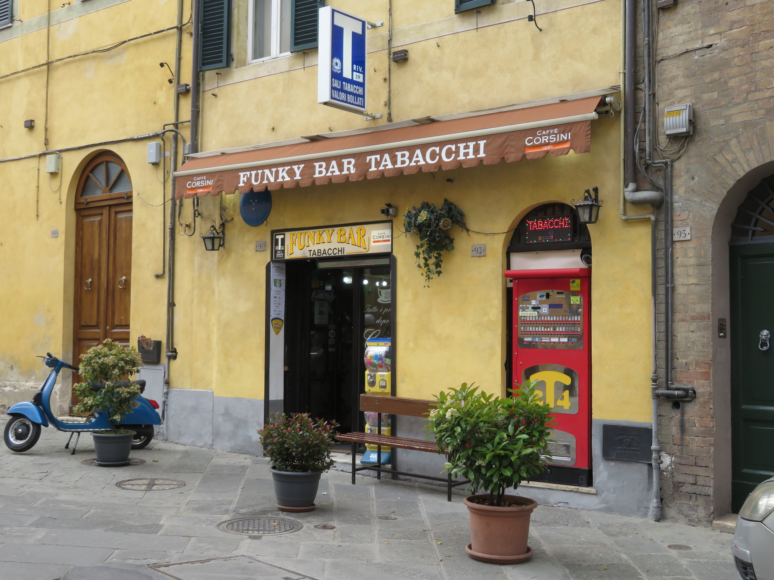 A bar/tabacchi in Italy serves coffee, morning pastries and also offers alcohol, cigarettes, lotto tickets and bus tickets.