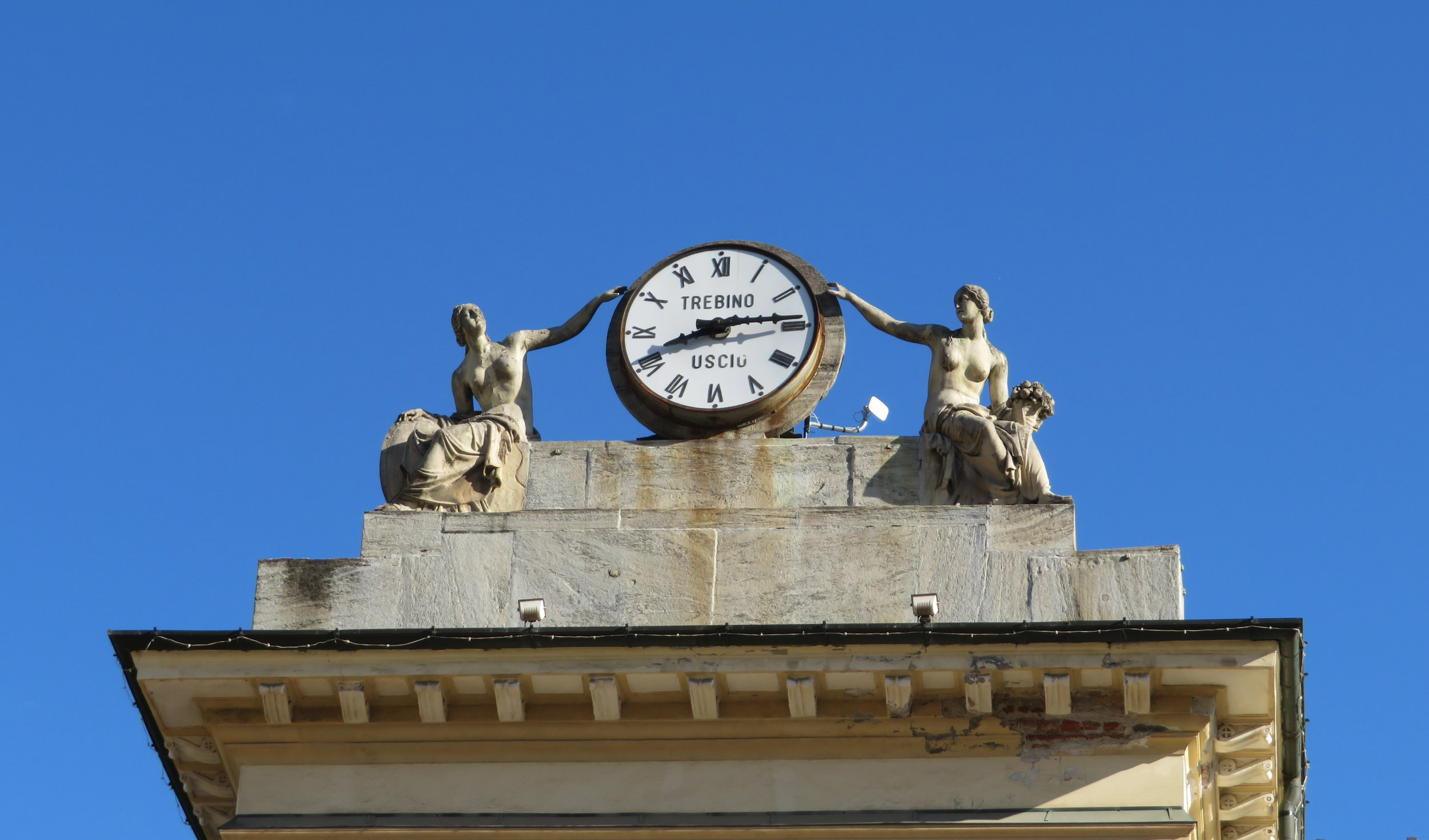 Town clock at Piazza Emile Chanoux during a sunny, but brief respite from the rain.