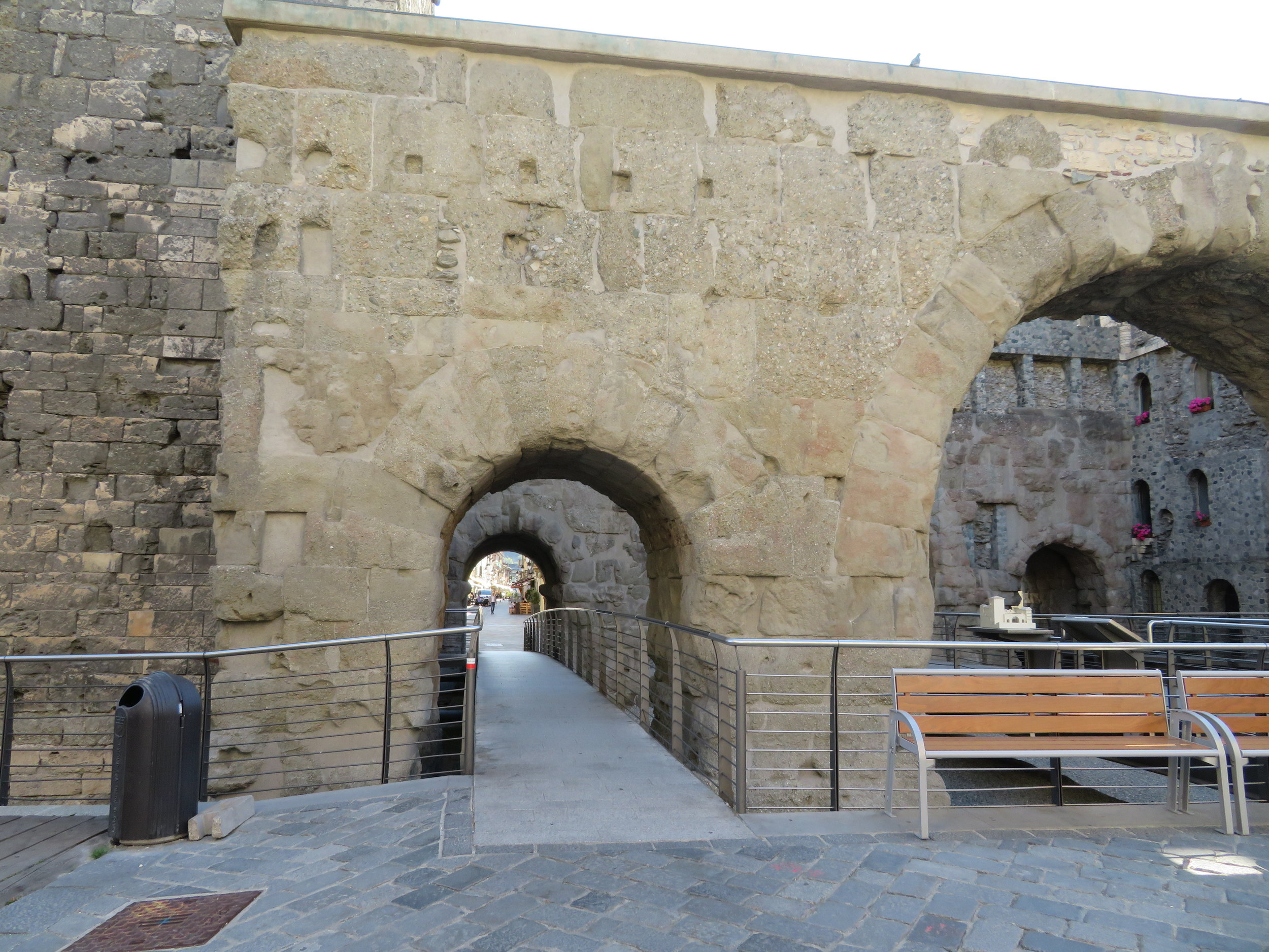 Porta Praetoria, an old 3-arched portal to the city, has two narrower arched ports for pedestrians and a wider central arched port for wagons.