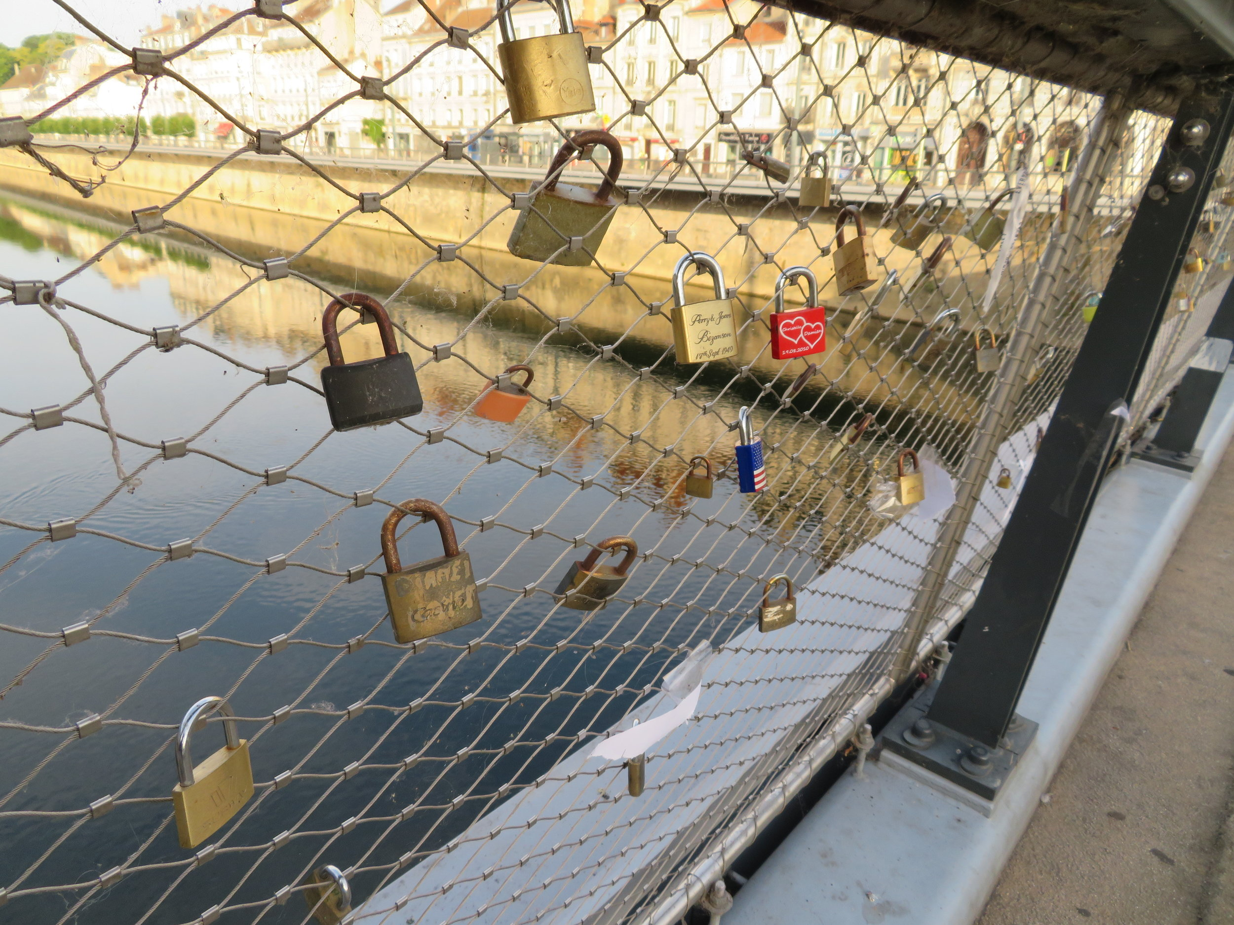 Lovelocks on the bridge leaving Besançon