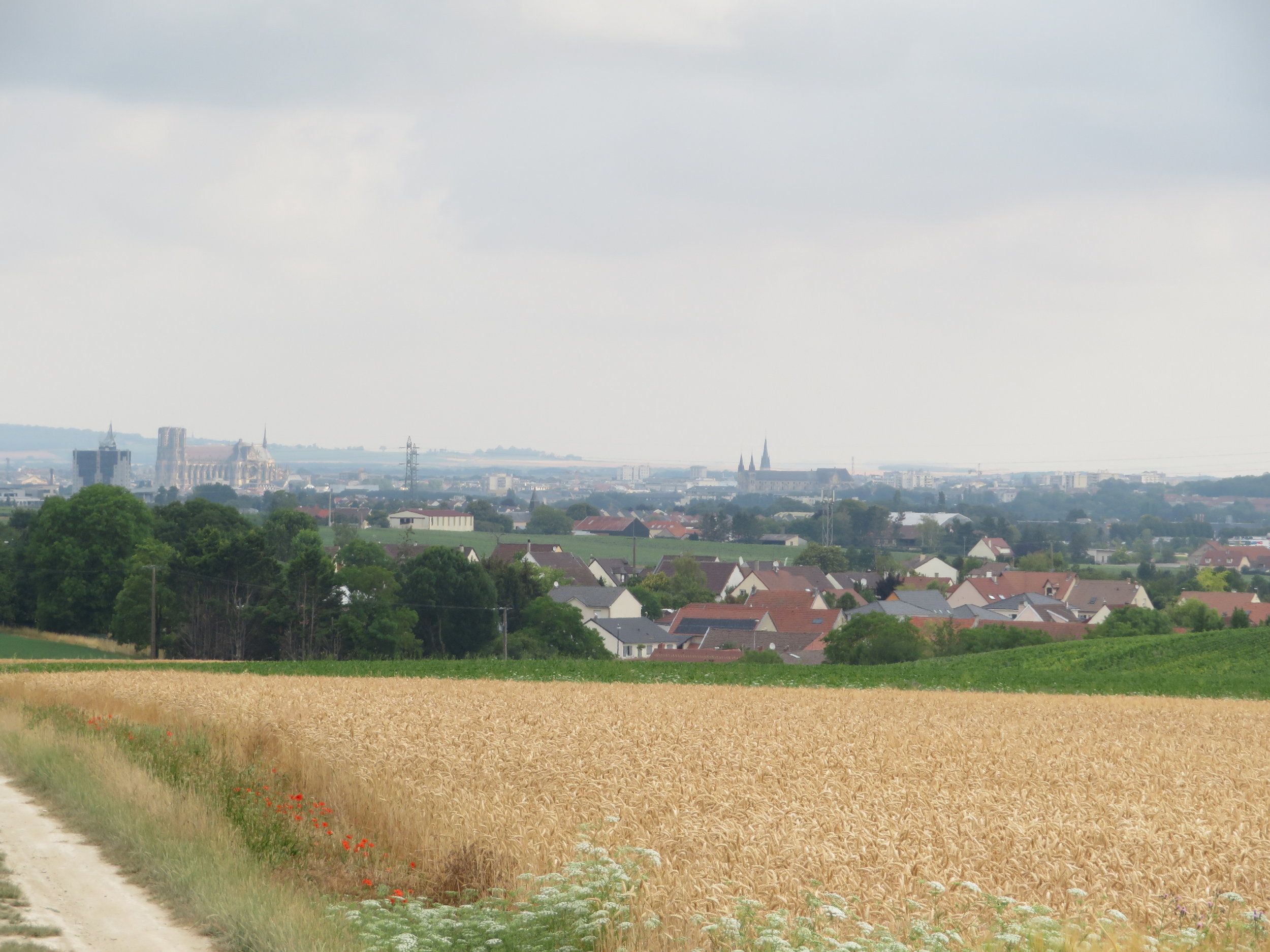 The skyline of Reims in the distance