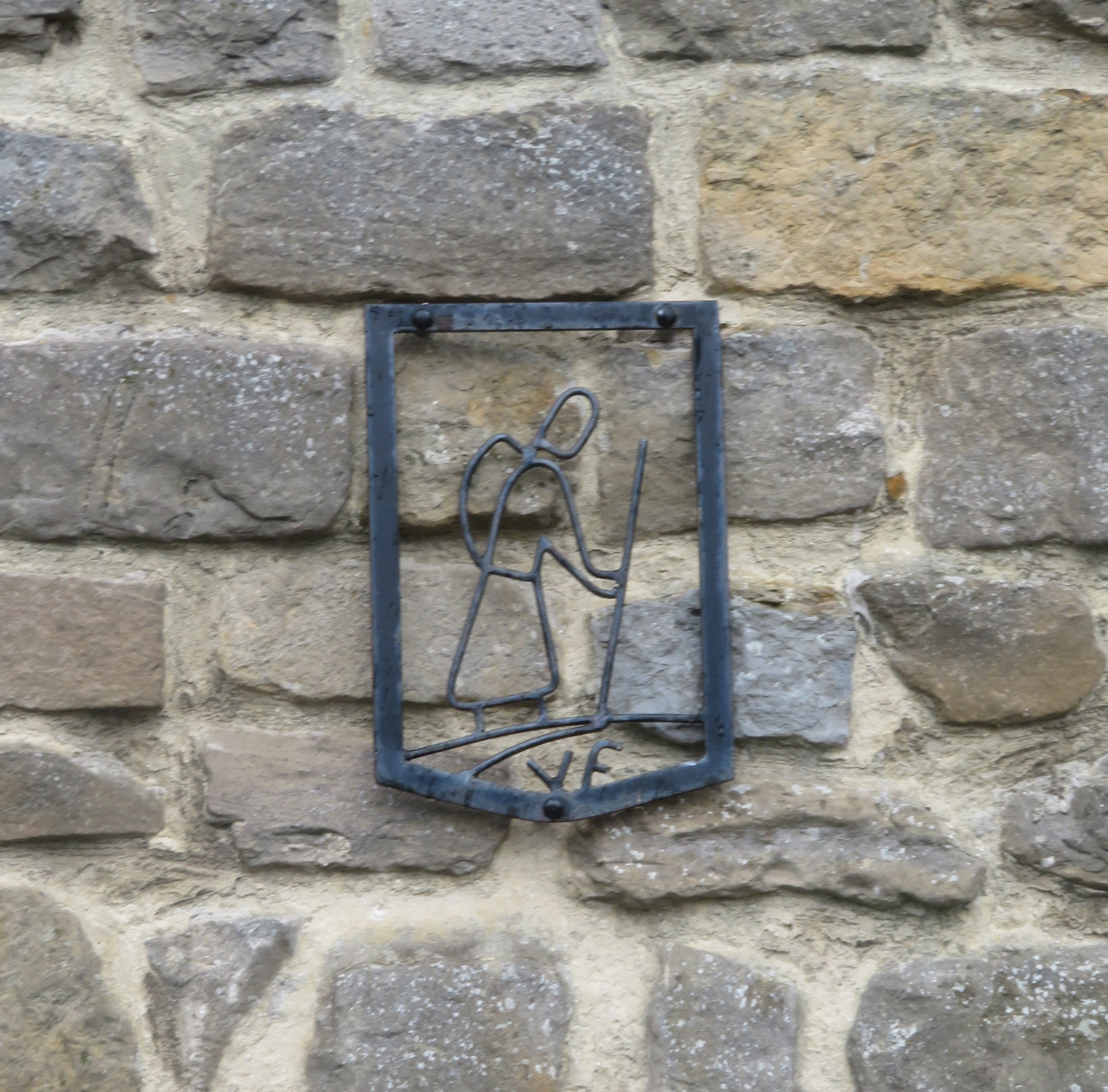 A metal symbol on the church signifies its pilgrim heritage and its centuries long connection to the Via Francigena (VF).