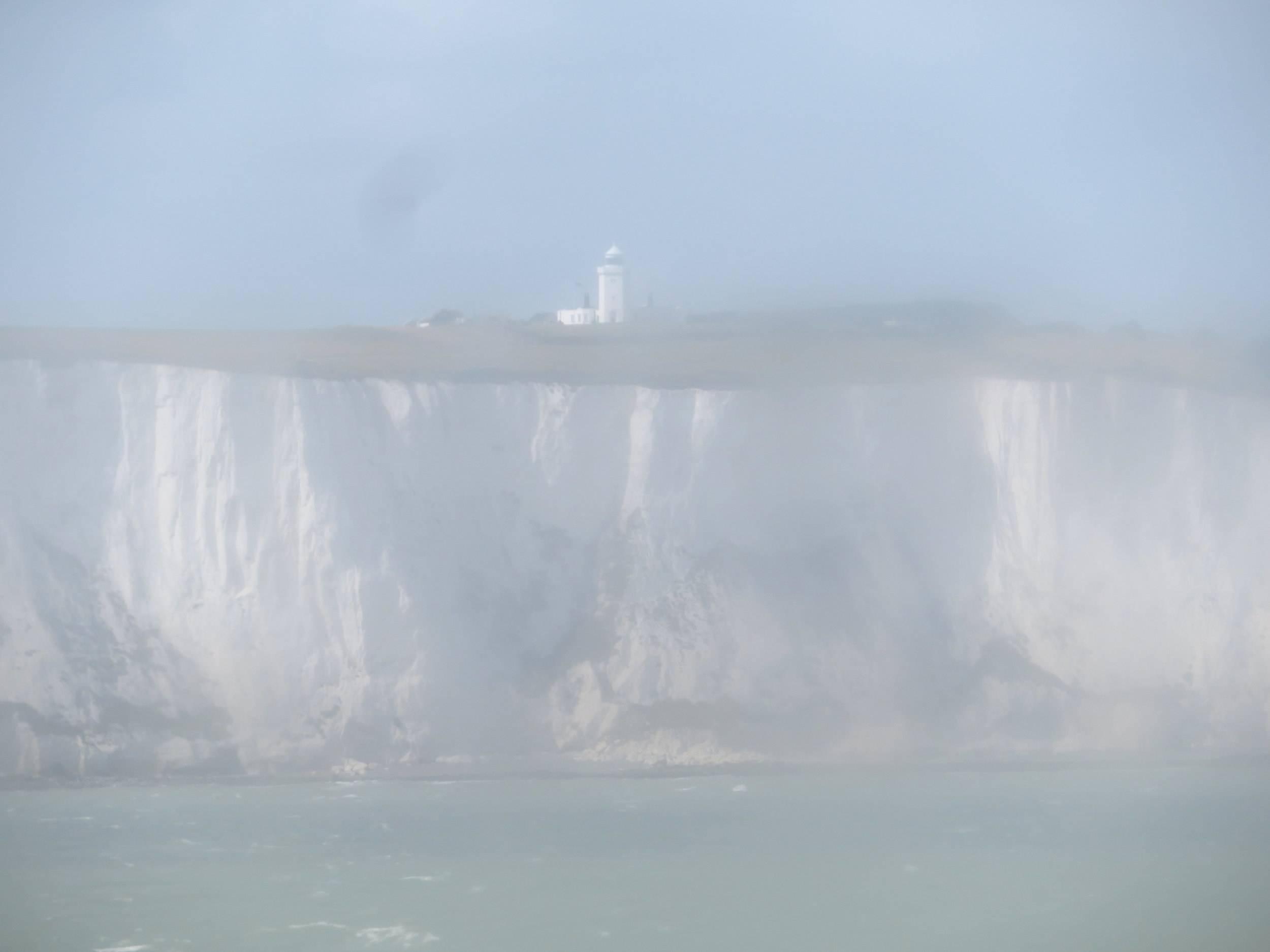 Through the salt sprayed windows on the ferry, we could make out a blurry view of the White Cliffs of Dover and the Dover Light.