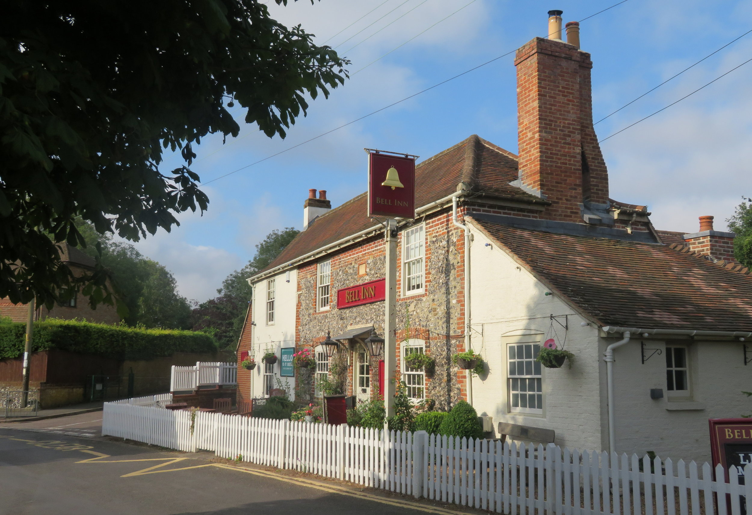 "Bell Inn Pub … As a sign proclaimed 'Our village pub is the hub!""'"