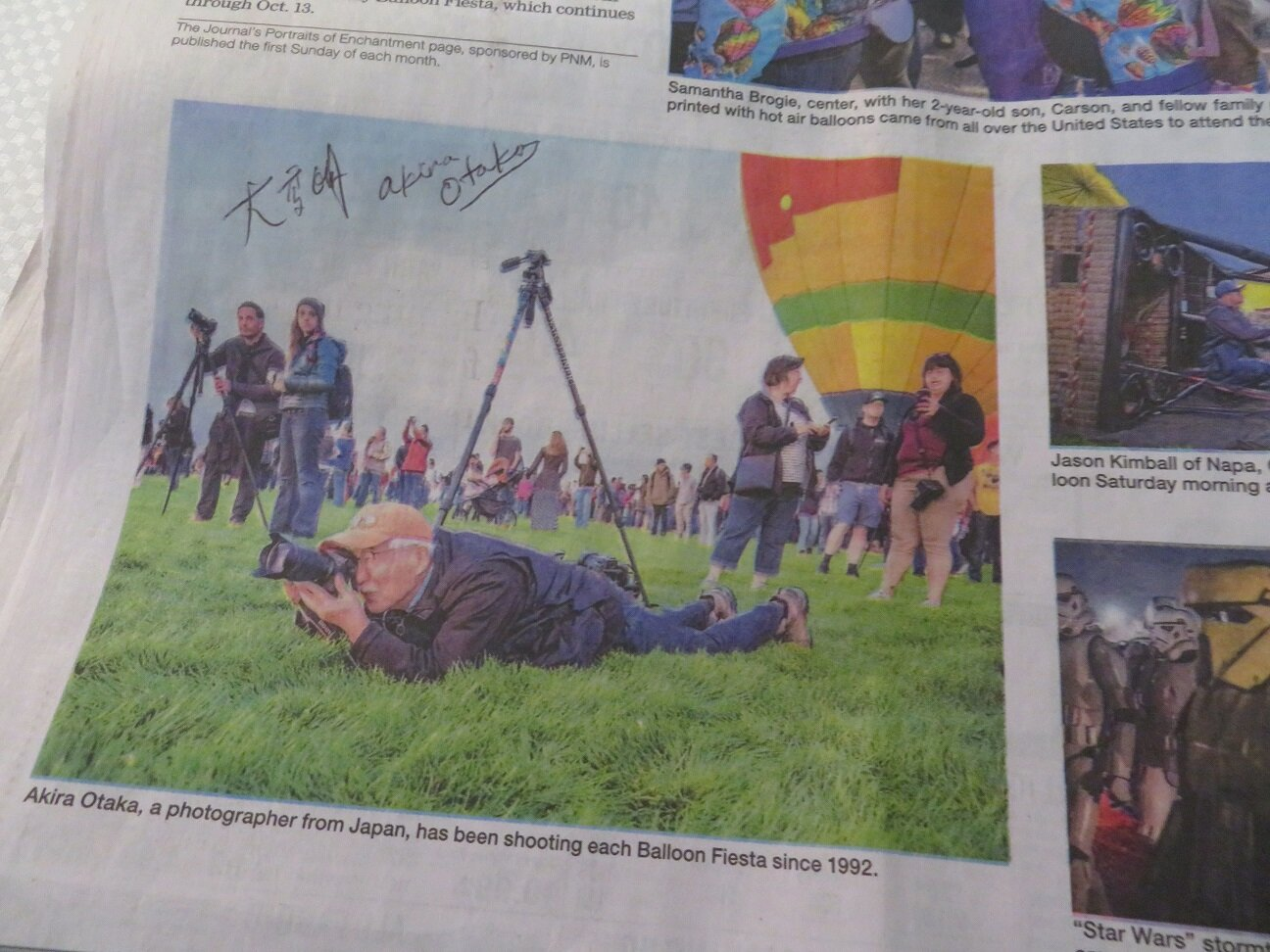 Mr. Otaka autographed the photo of him in the Sunday Journal —- Photo credit: R. Rosales/Jouranl