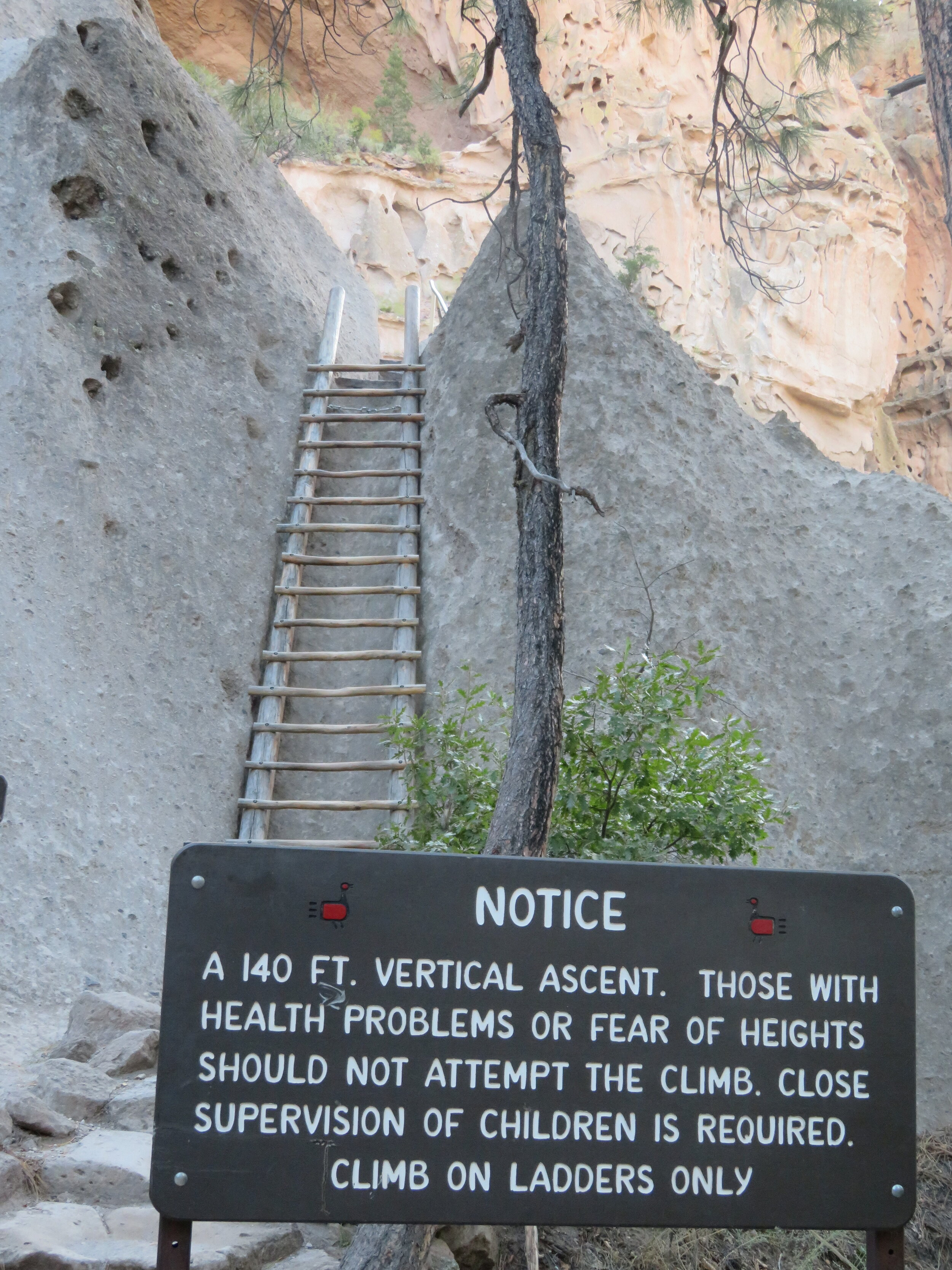 Access to the Alcove House ceremonial cave with lots of posted warnings.