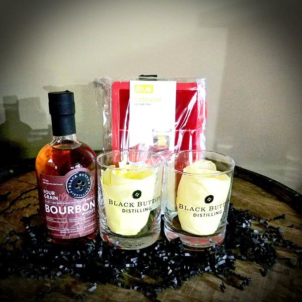 Bourbon Lover - Four Grain Bourbon paired with over-sized cube molds and a pair of classic Black Button rocks glasses