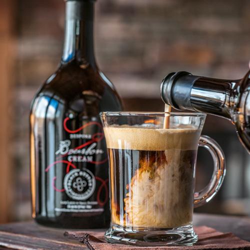 Black Button Distilling Award Winning Bourbon Cream Bottle with Cocktail