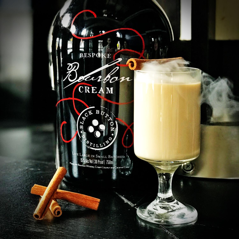 Black Button Distilling award winning bourbon cream next to bourbon cream cocktail
