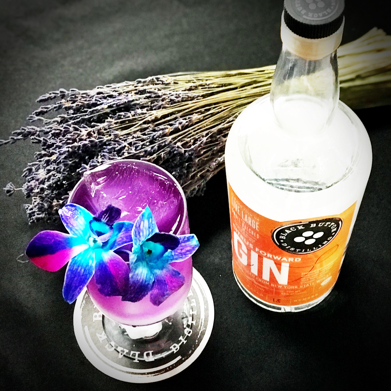 Black Button Distilling's award winning citrus forward gin paired with cocktail