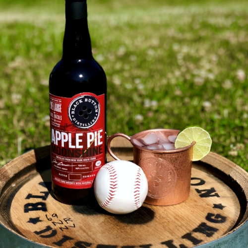 Black Button Distilling Award Winning Apple Pie moonshine with cocktail