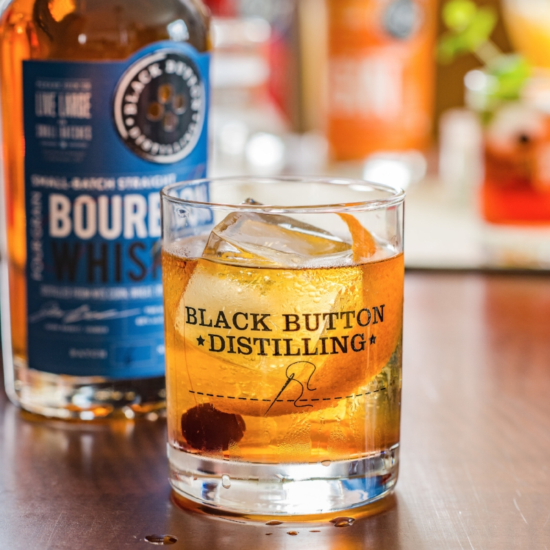 Black Button Distilling's Bourbon Whiskey bottle and cocktail