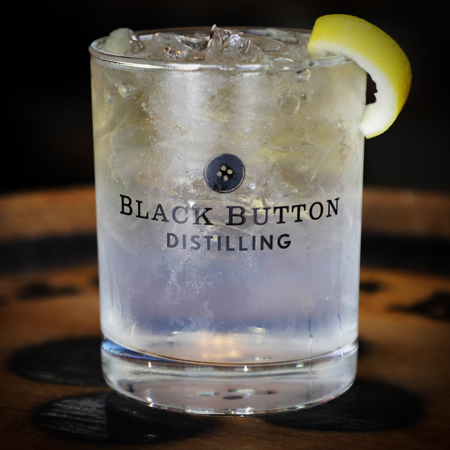 Black Button Distilling award winning citrus forward gin in a cocktail garnished with lemon