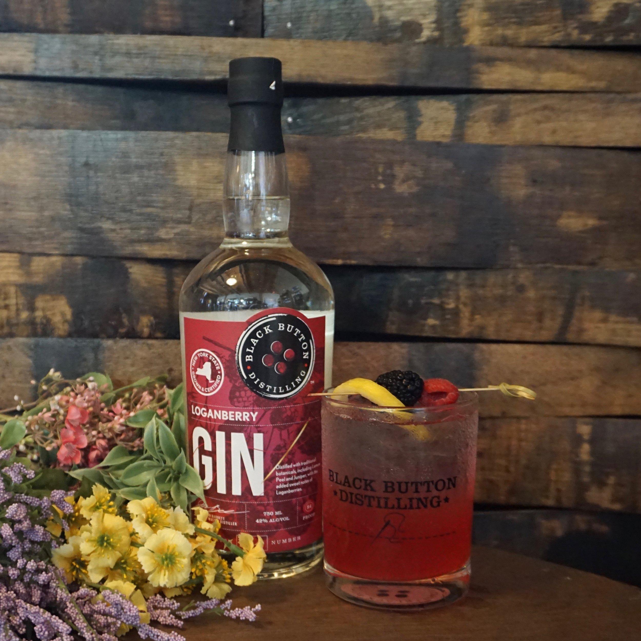 Black Button Distilling award winning loganberry gin next to a loganberry gin cocktail