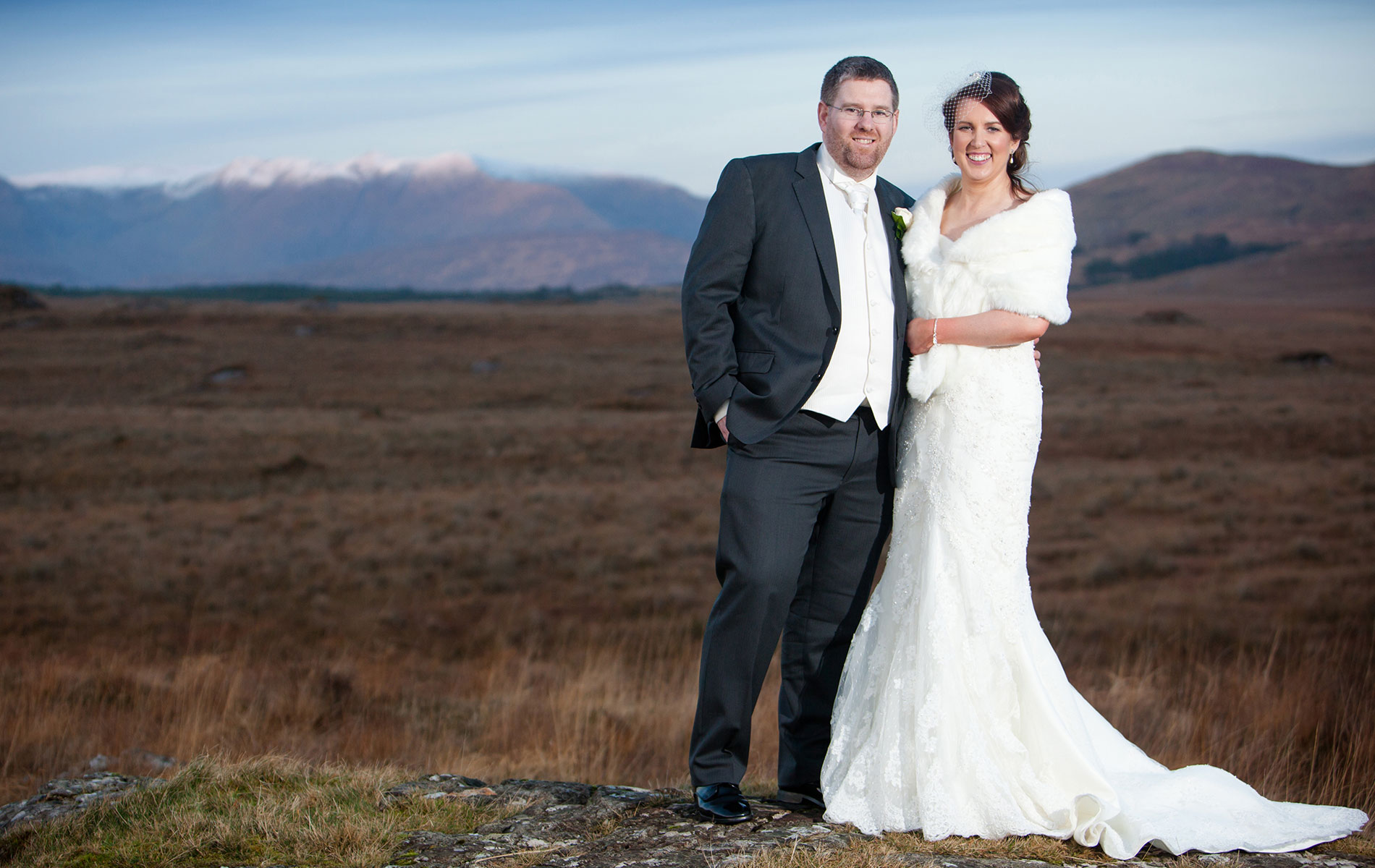 Ann-Marie Aspell and Tom O'Neill pose in front of a Connemara Landscape on their wedding day